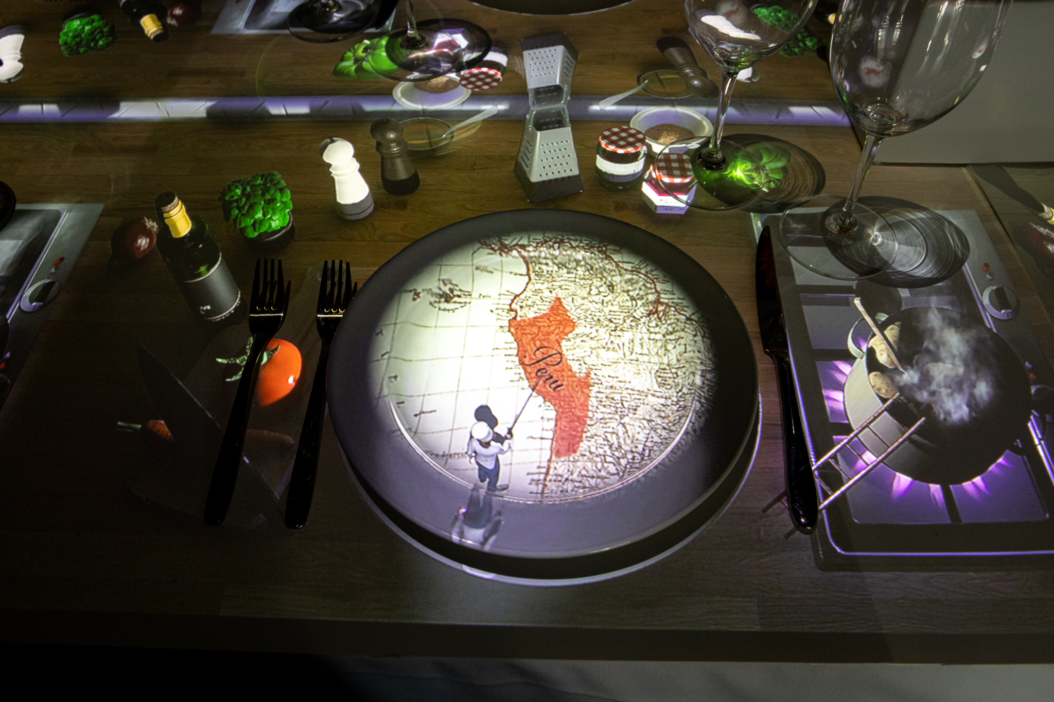 Mapping projection technology makes an image of a chef and a map of Peru on a place