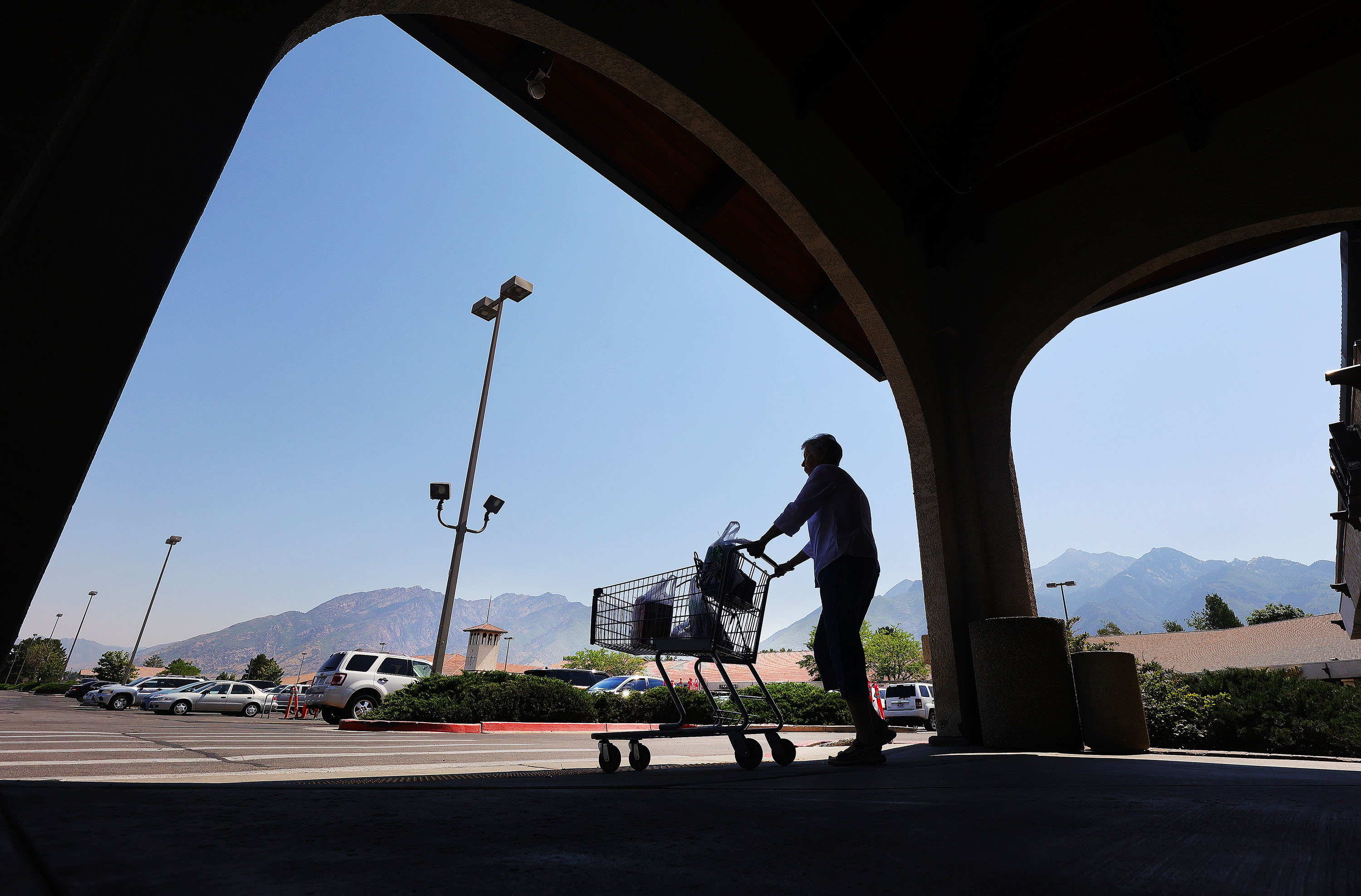 A shopper carts food to a car at Reams in Sandy on Friday, July 9, 2021. In a new Deseret News/Hinckley Institute of Politics poll, an overwhelming majority of Utahns said they were concerned about rising prices amid the economic recovery from COVID-19.