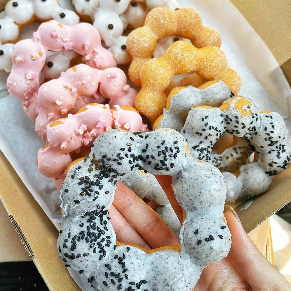 A box containing a handful of the more than two dozen doughnut varieties on the menu at Mochinut.