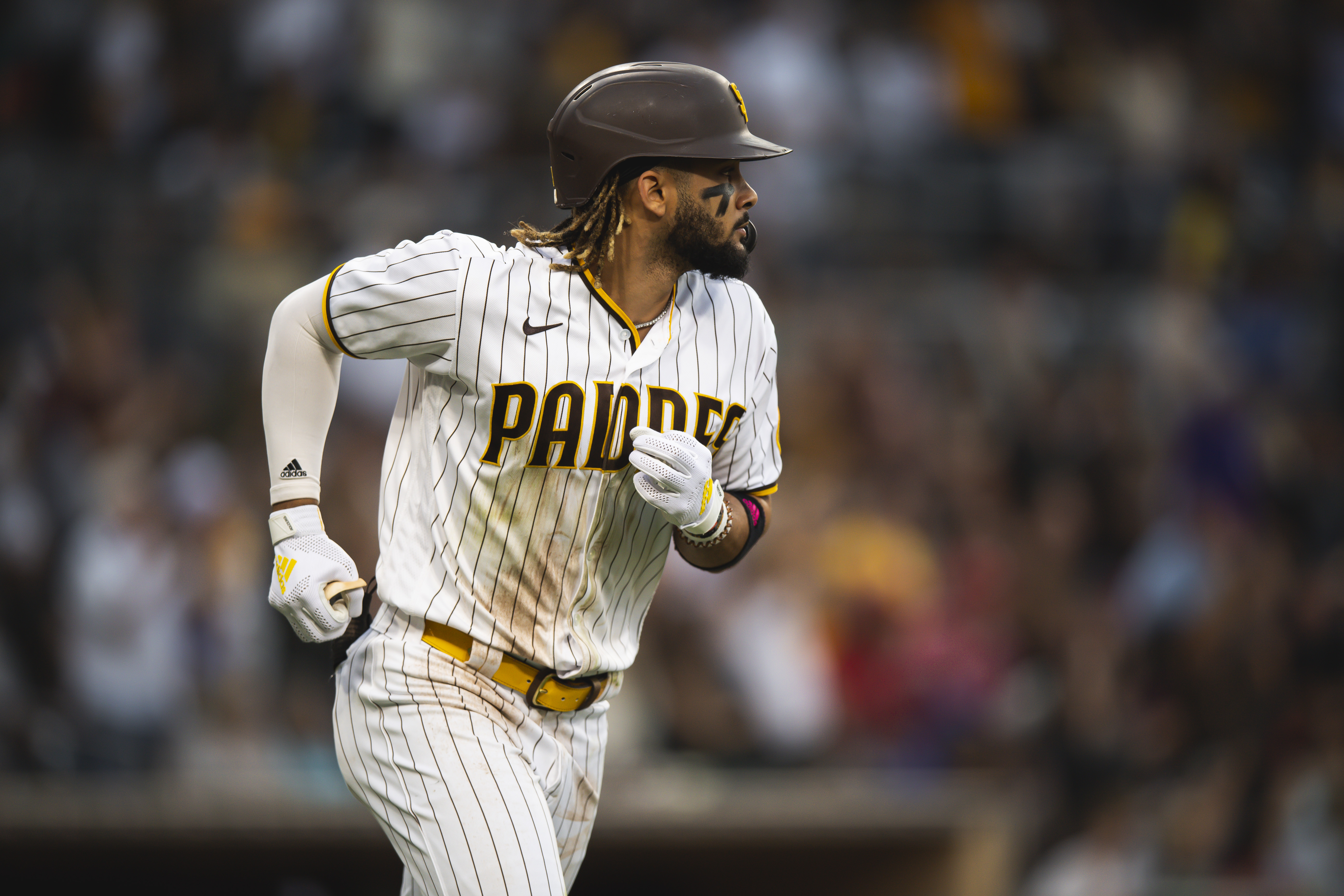 Fernando Tatis Jr #23 of the San Diego Padres hits a home run in the fourth inning against the Washington Nationals on July 8, 2021 at Petco Park in San Diego, California.