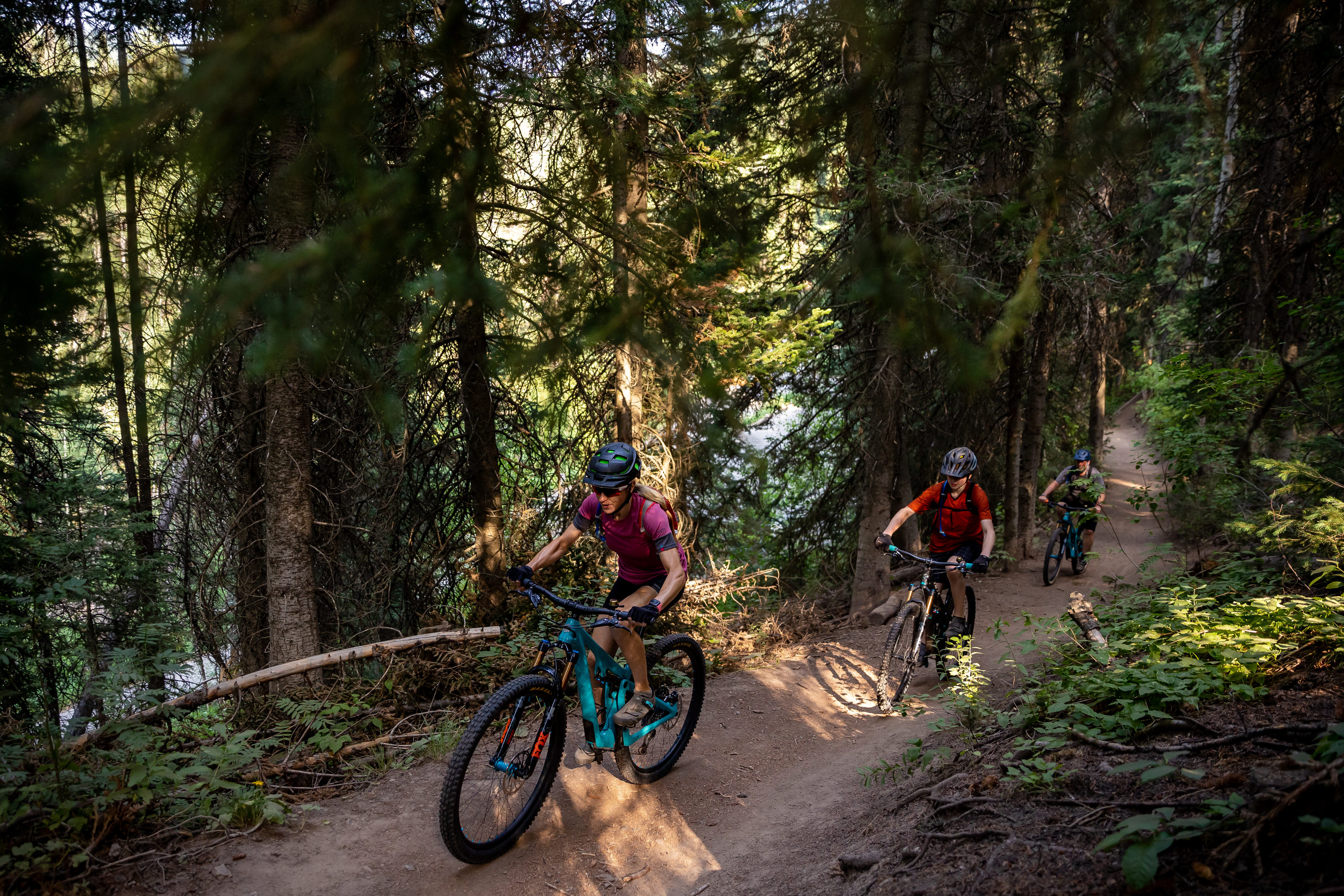 Heather King, left, and Michael King, right, and their son, Seth, 14, ride mountain bikes on the Big Water Trail in Millcreek Canyon on Monday, July 12, 2021.