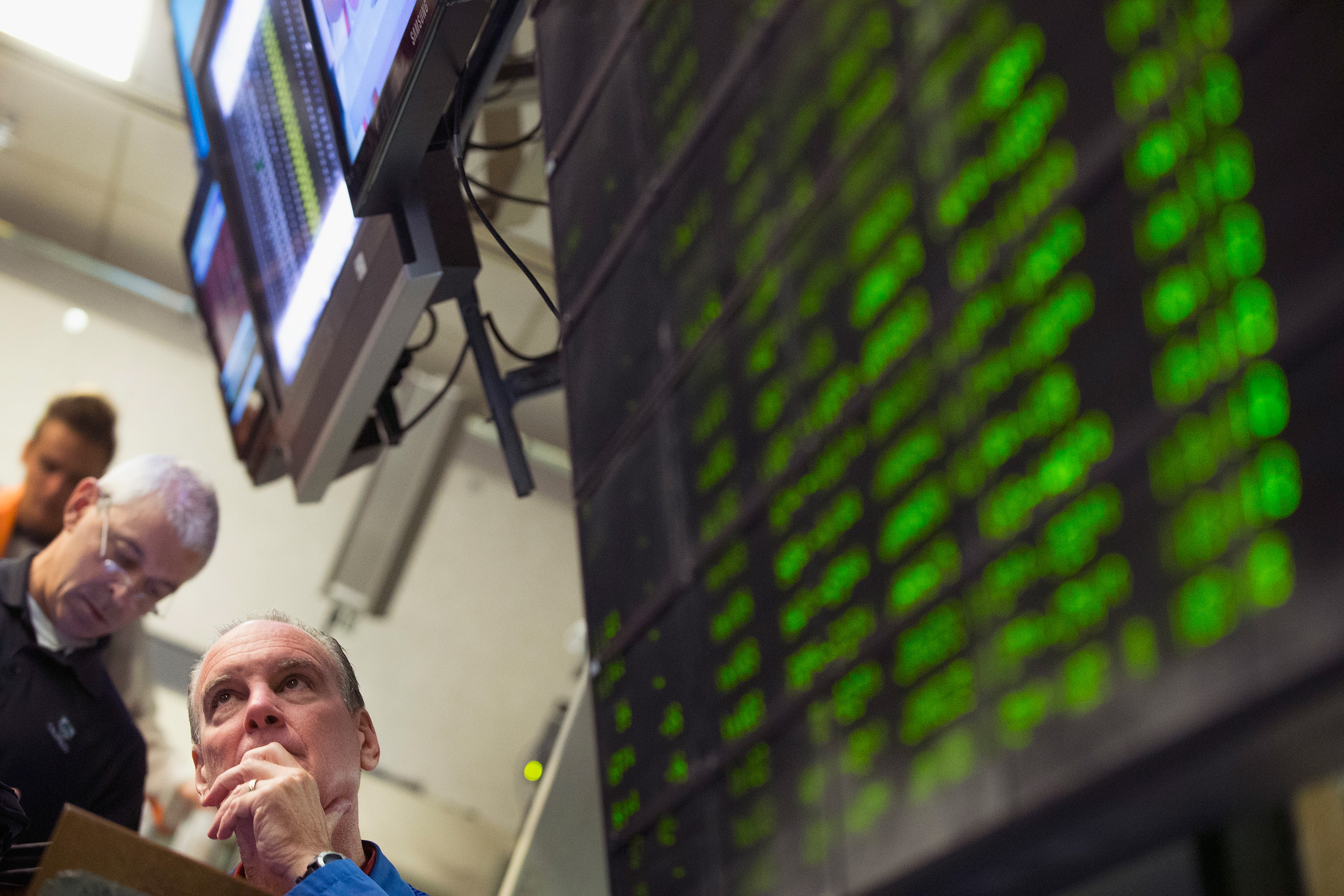 A trader monitors offers in the Standard & Poor's 500 stock index options pit at the Chicago Board Options Exchange (CBOE) on August 24, 2015 in Chicago, Illinois.
