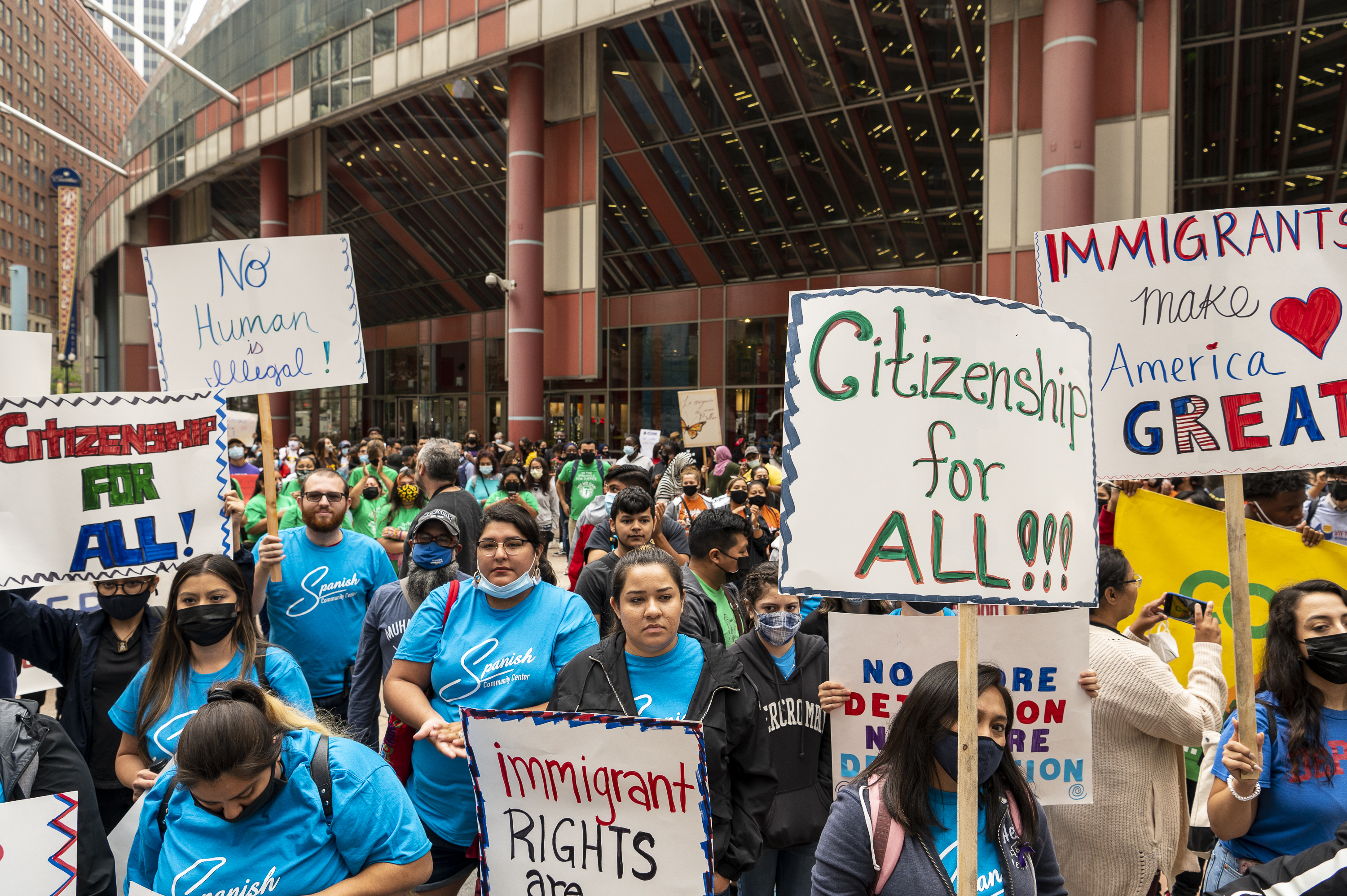 A few hundred people rally at the Thompson Center, demanding a pathway to citizenship for all and the end to deportation, Thursday, July 8, 2021.