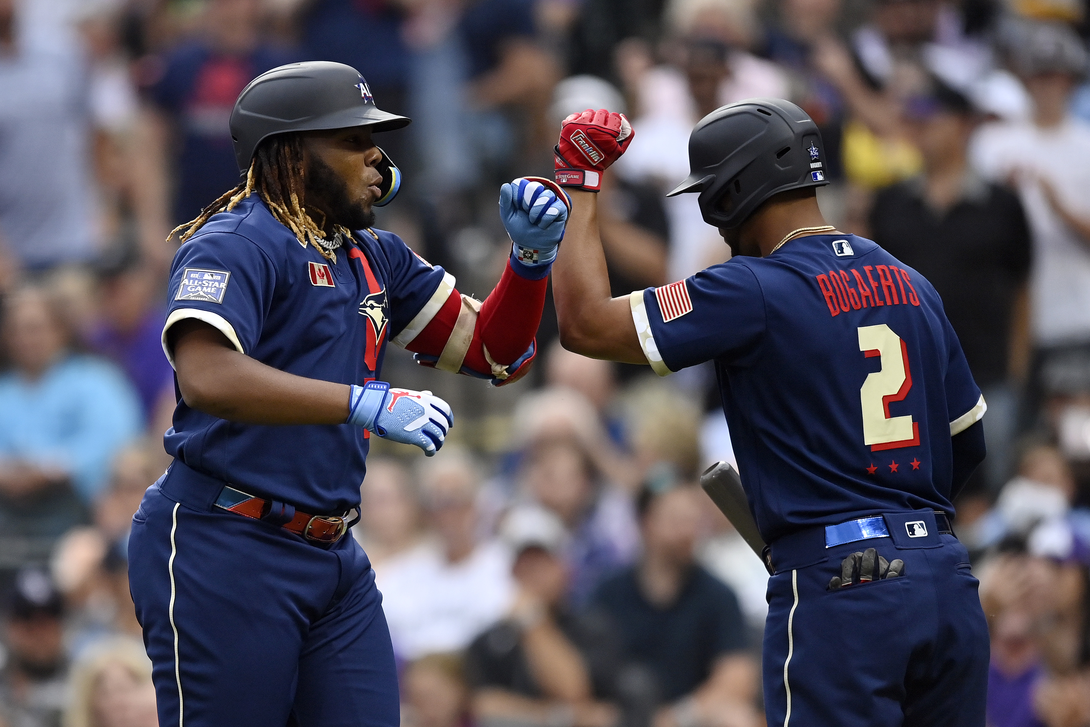 Vladimir Guerrero Jr. #27 of the Toronto Blue Jays celebrates with Xander Bogaerts #2 of the Boston Red Sox after hitting a home run in the third inning during the 91st MLB All-Star Game at Coors Field on July 13, 2021 in Denver, Colorado.