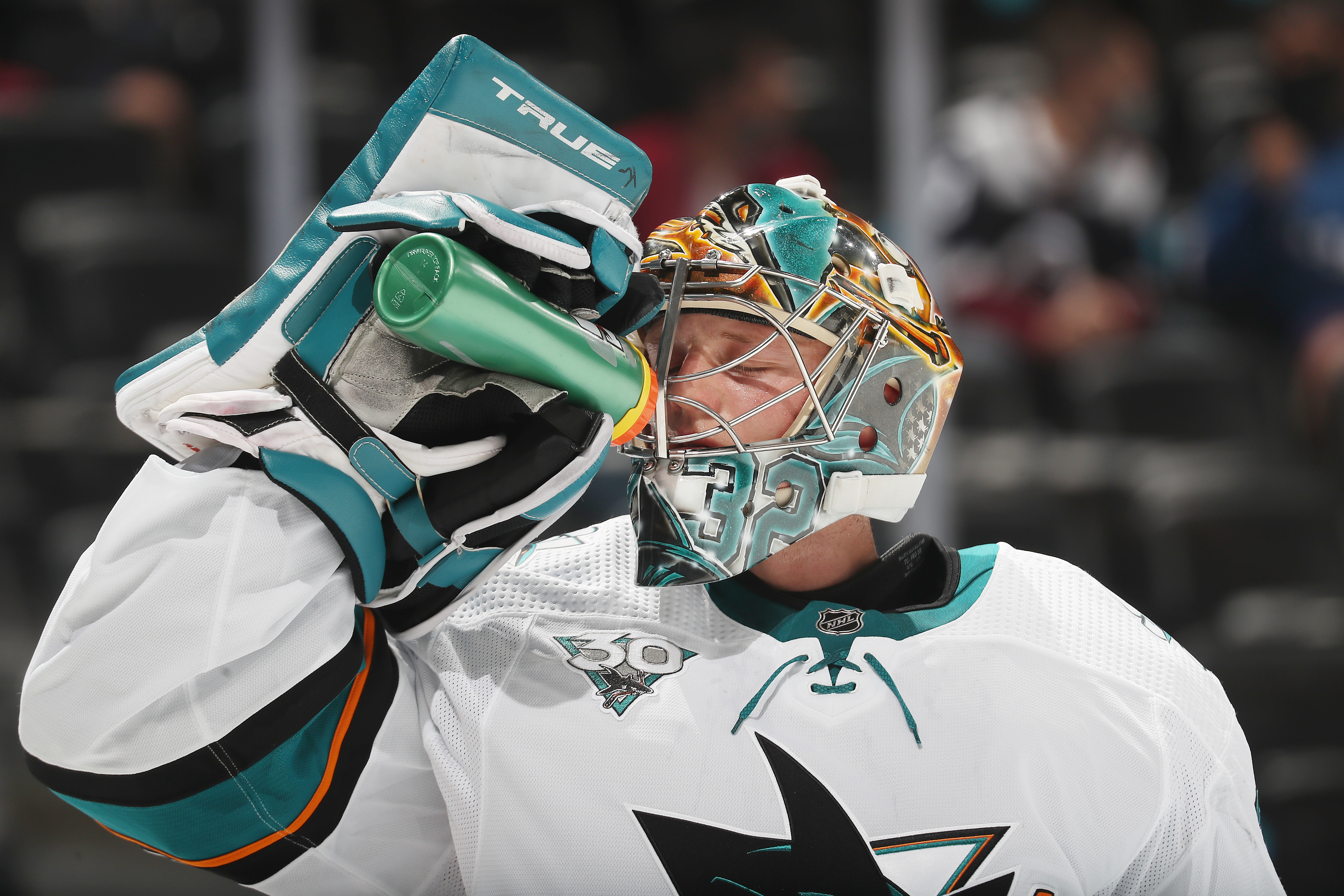 Goaltender Josef Korenar #32 of the San Jose Sharks drinks from a Gatorade bottle during a break in the action against the Colorado Avalanche at Ball Arena on May 1, 2021 in Denver, Colorado.