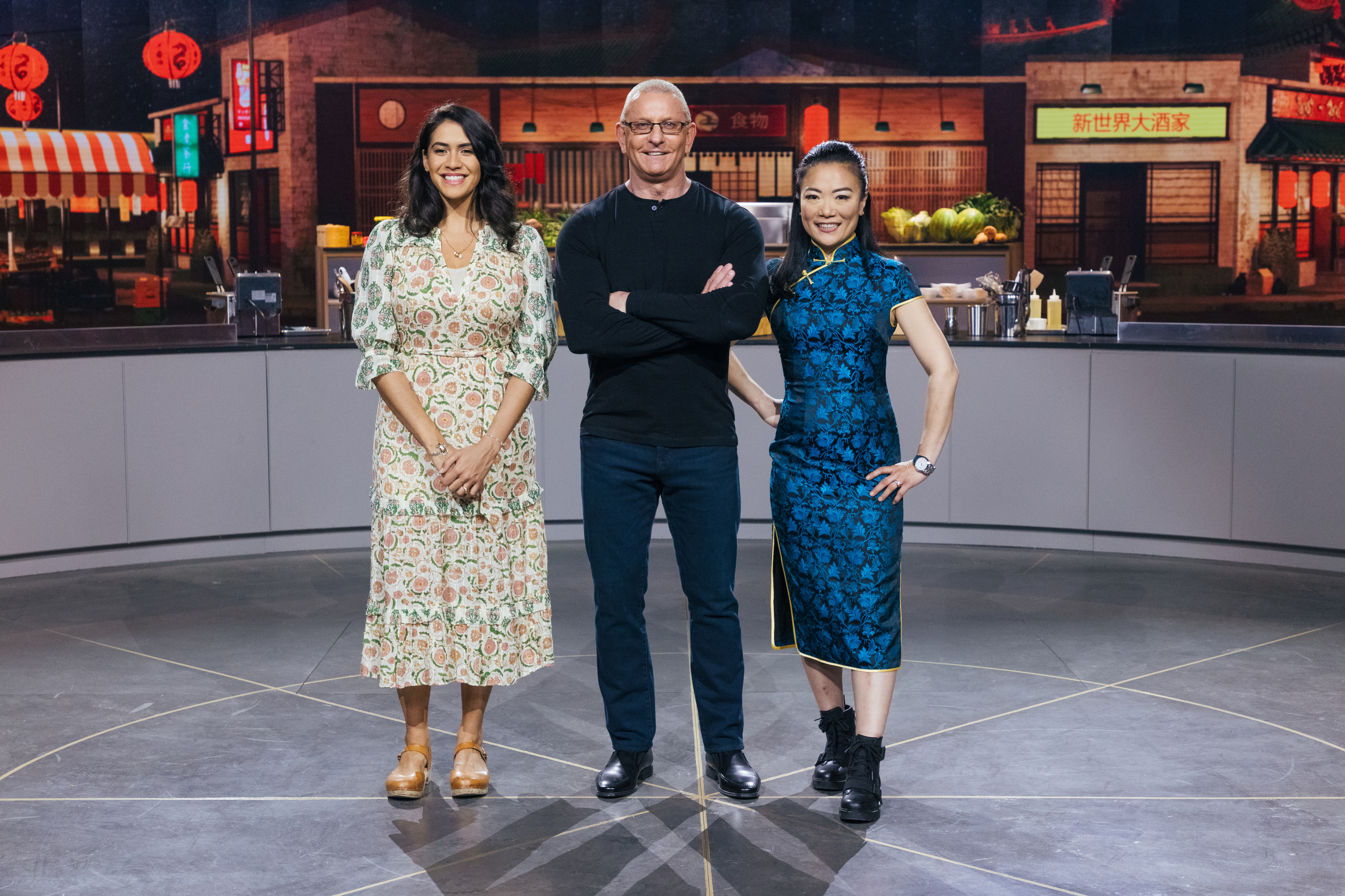 """Host Robert Irvine with judge Daniela Soto-Innes (left) and Judge Shirley Chung, are shown in an episode of the Discovery+ series """"The Globe."""""""