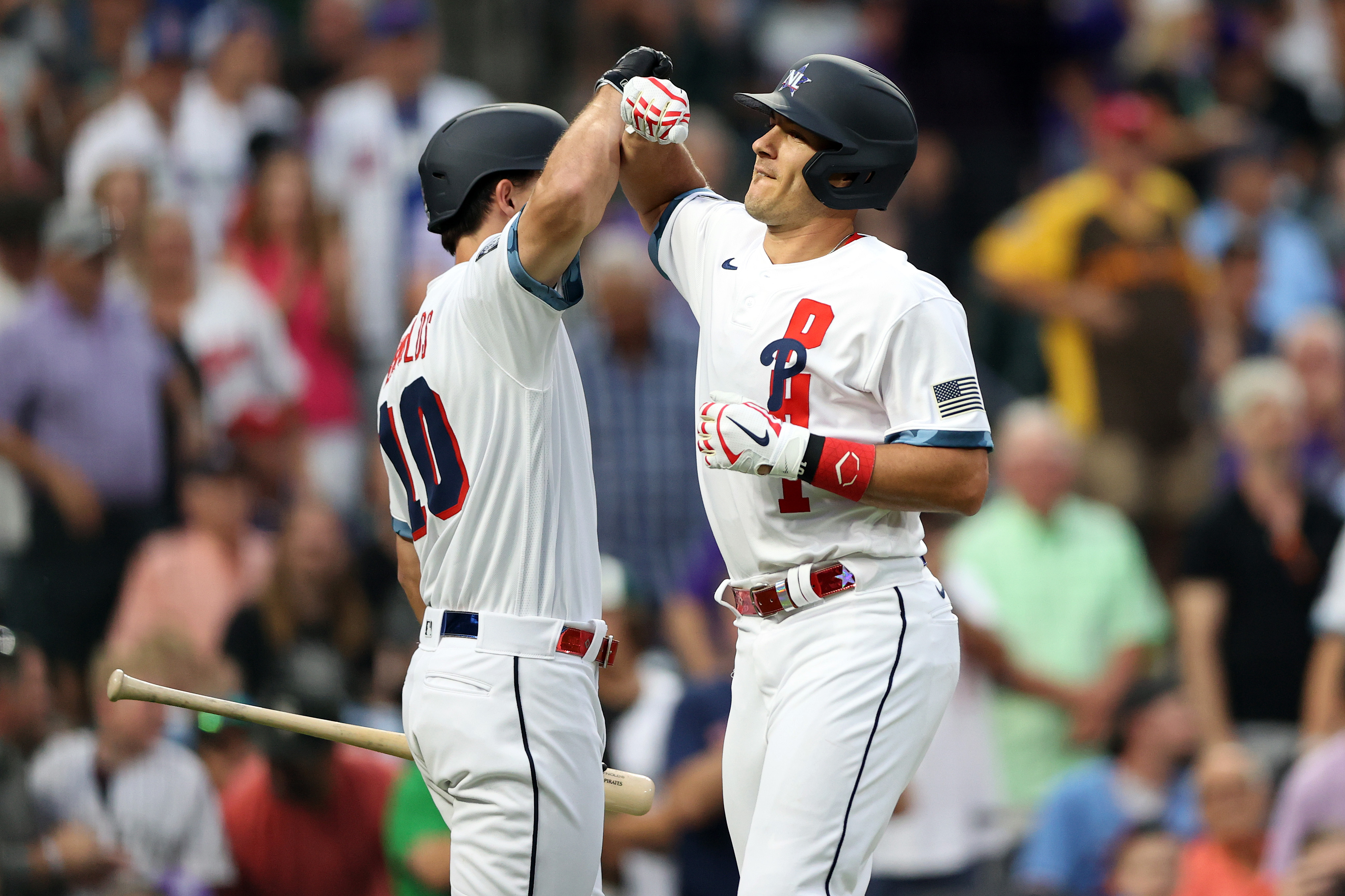 J.T. Realmuto #10 of the Philadelphia Phillies celebrates Bryan Reynolds #10 of the Pittsburgh Pirates with after hitting a home run in the fifth inning during the 91st MLB All-Star Game at Coors Field