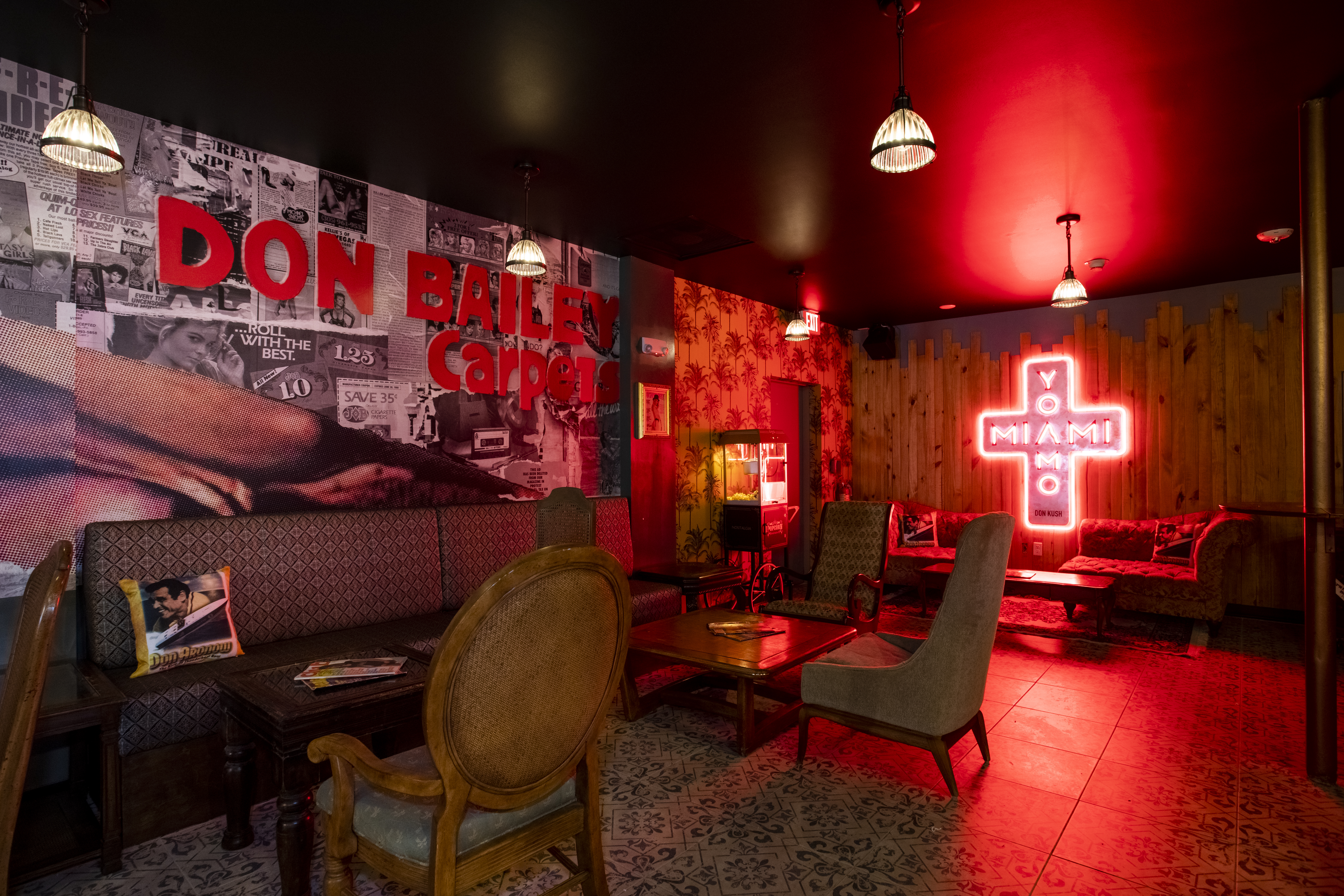 dark bar with red lighting and collage in the background