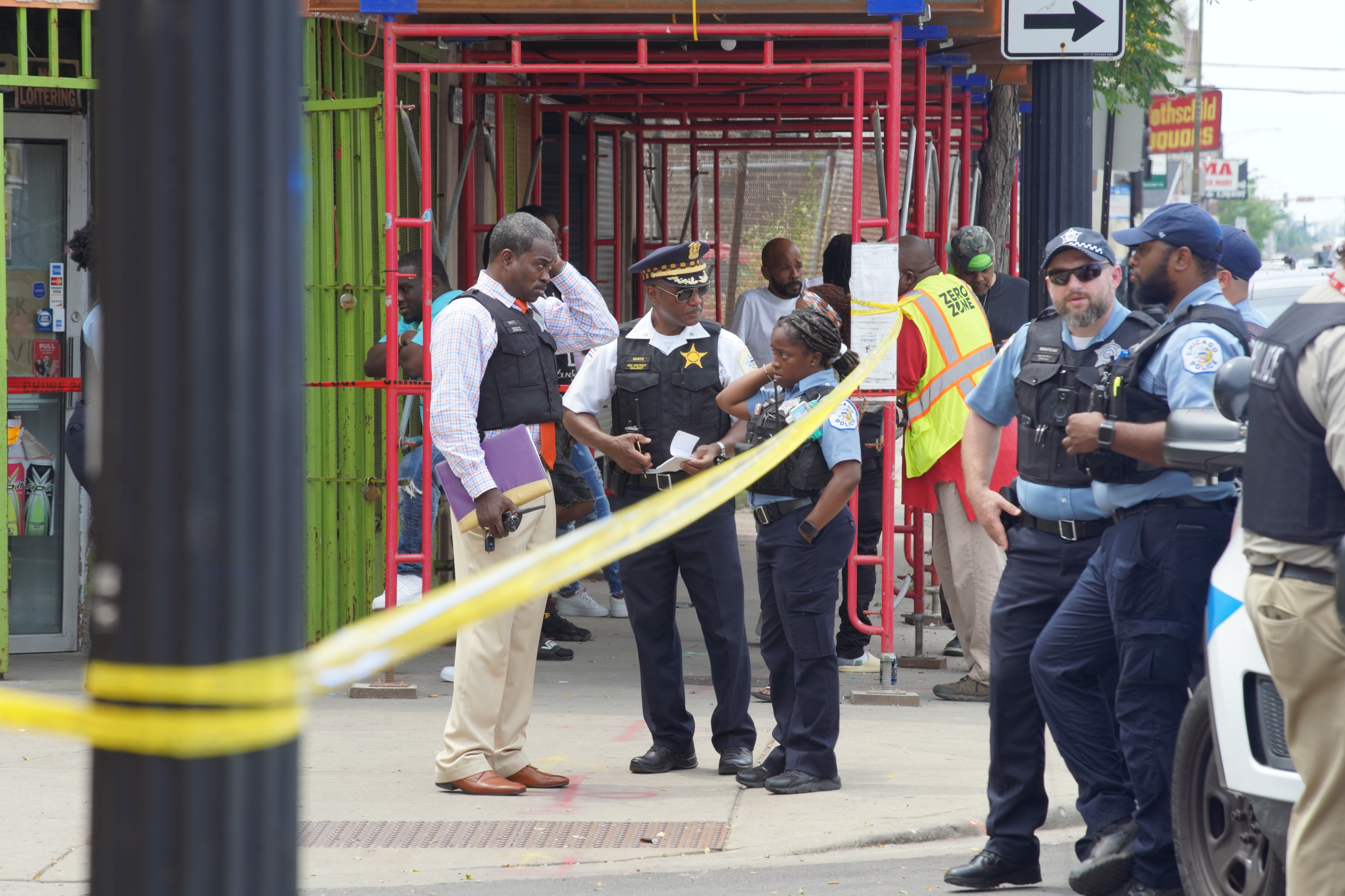 Police investigate at the site of a mass shooting Wednesday, July 14 in the 7900 block of South Justine Street.