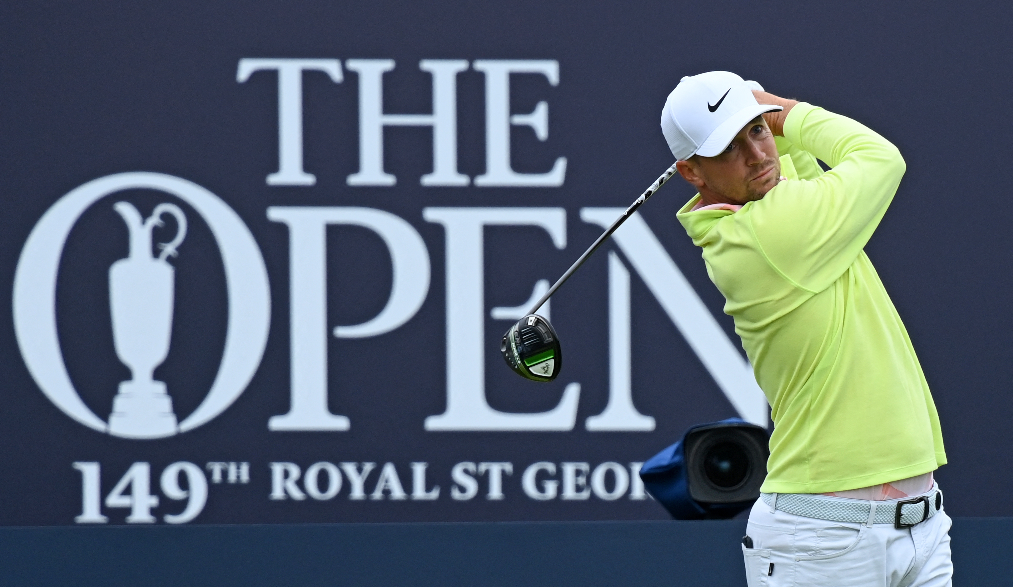 Sweden's Alex Noren watches his drive from the 1st tee during a practice round for The 149th British Open Golf Championship at Royal St George's, Sandwich in south-east England on July 14, 2021.