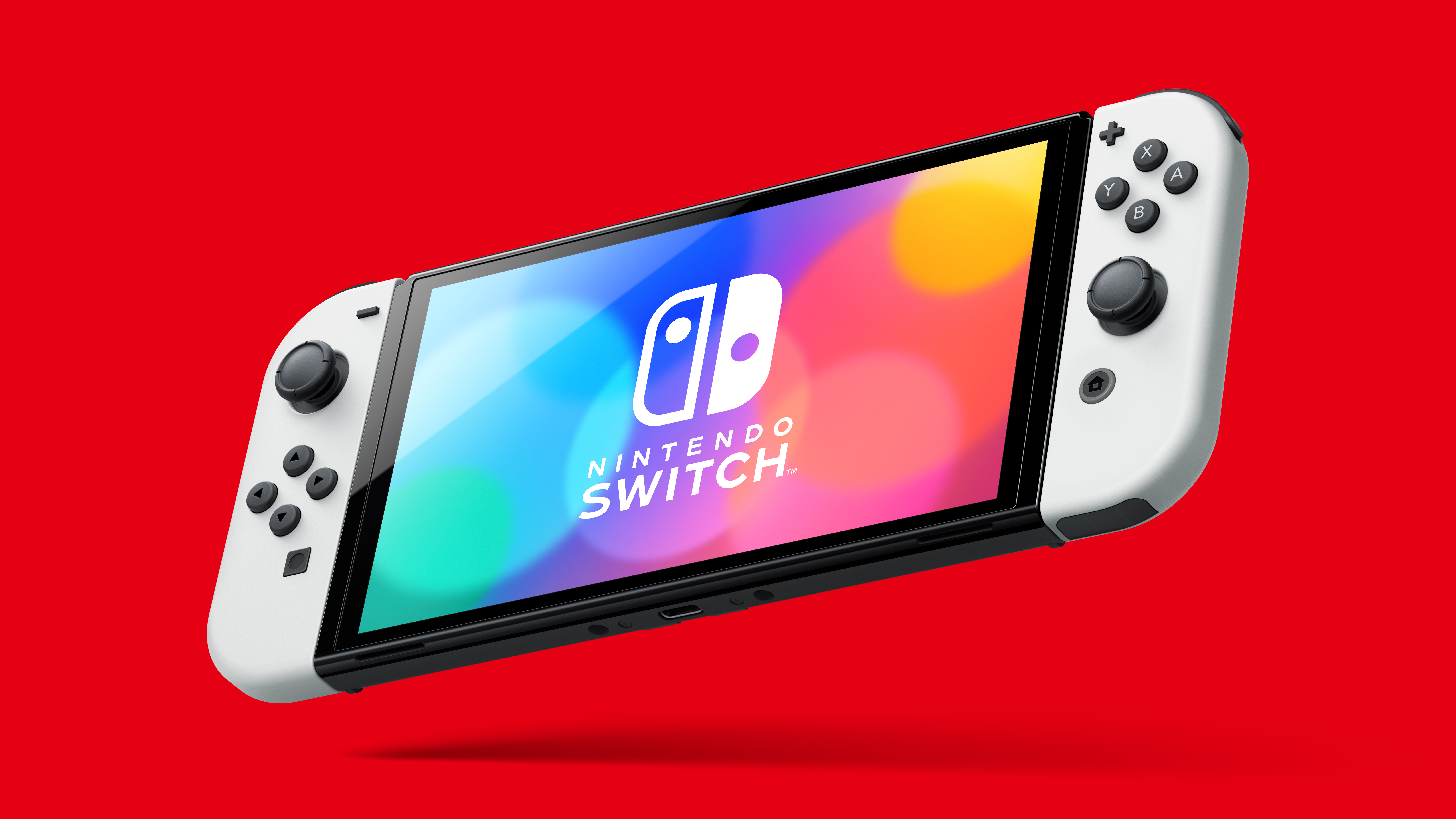 The new Nintendo Switch (OLED model) in handheld mode on a red background