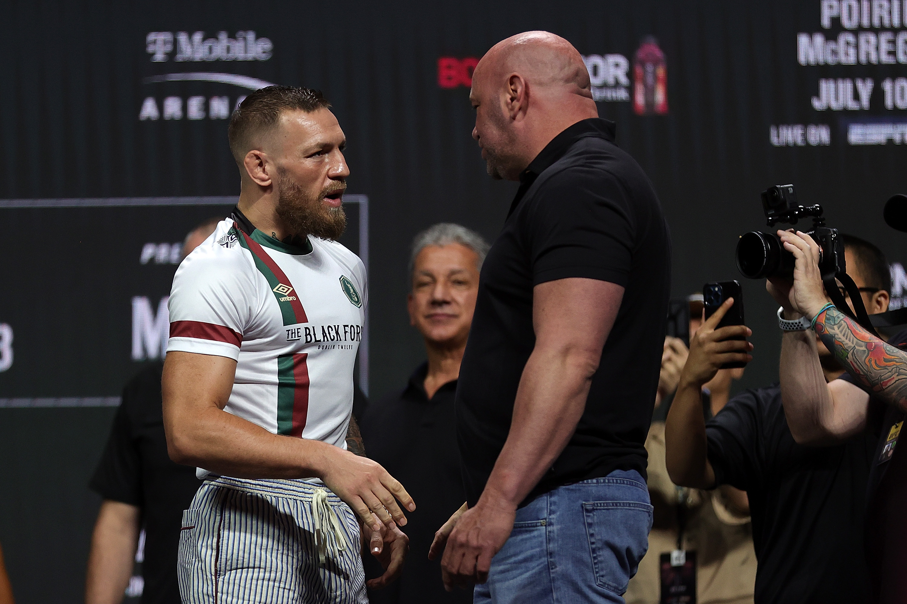 Dana White and Conor McGregor sharing the stage for the weigh-ins of UFC 264.
