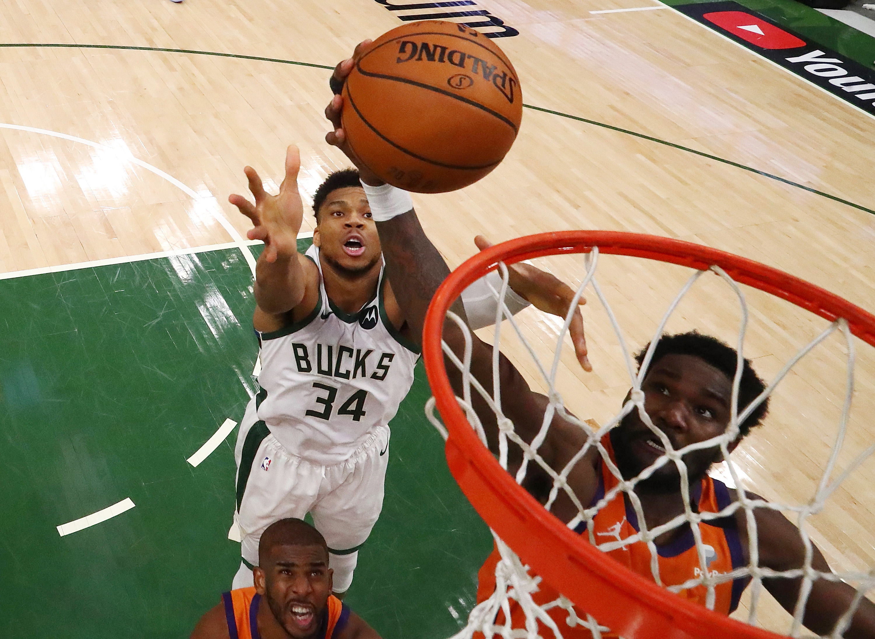 Deandre Ayton #22 of the Phoenix Suns goes up for a shot against Giannis Antetokounmpo #34 of the Milwaukee Bucks in Game Four of the NBA Finals at Fiserv Forum on July 14, 2021 in Milwaukee, Wisconsin.