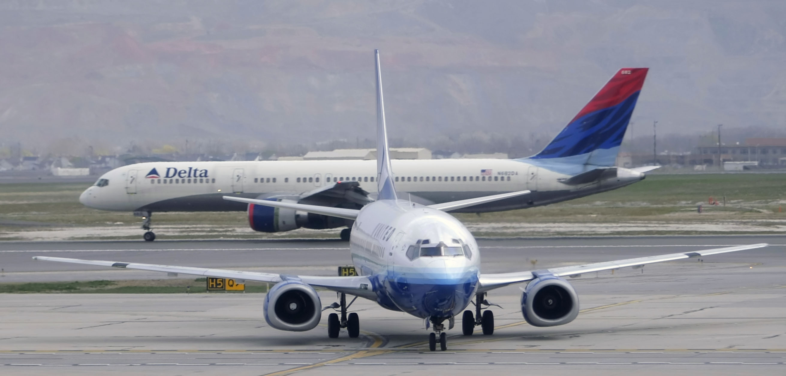United and Delta Airlines planes on a runway.