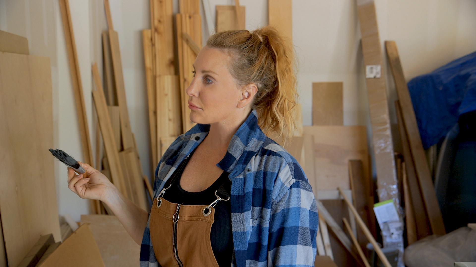 Amy Matthews with paint brush