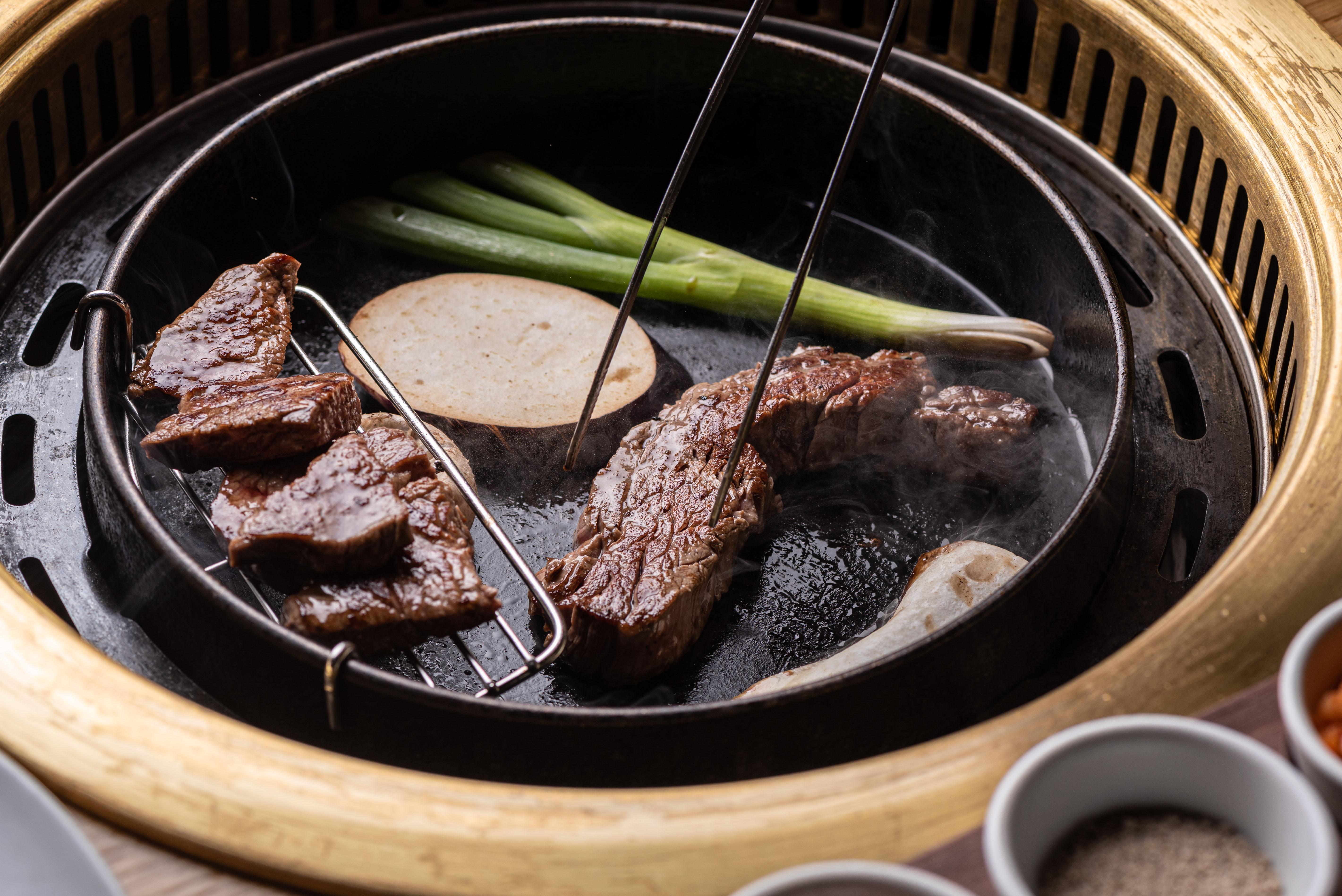 Grilling ribeye at Daedo Sikdang in LA's Koreatown.