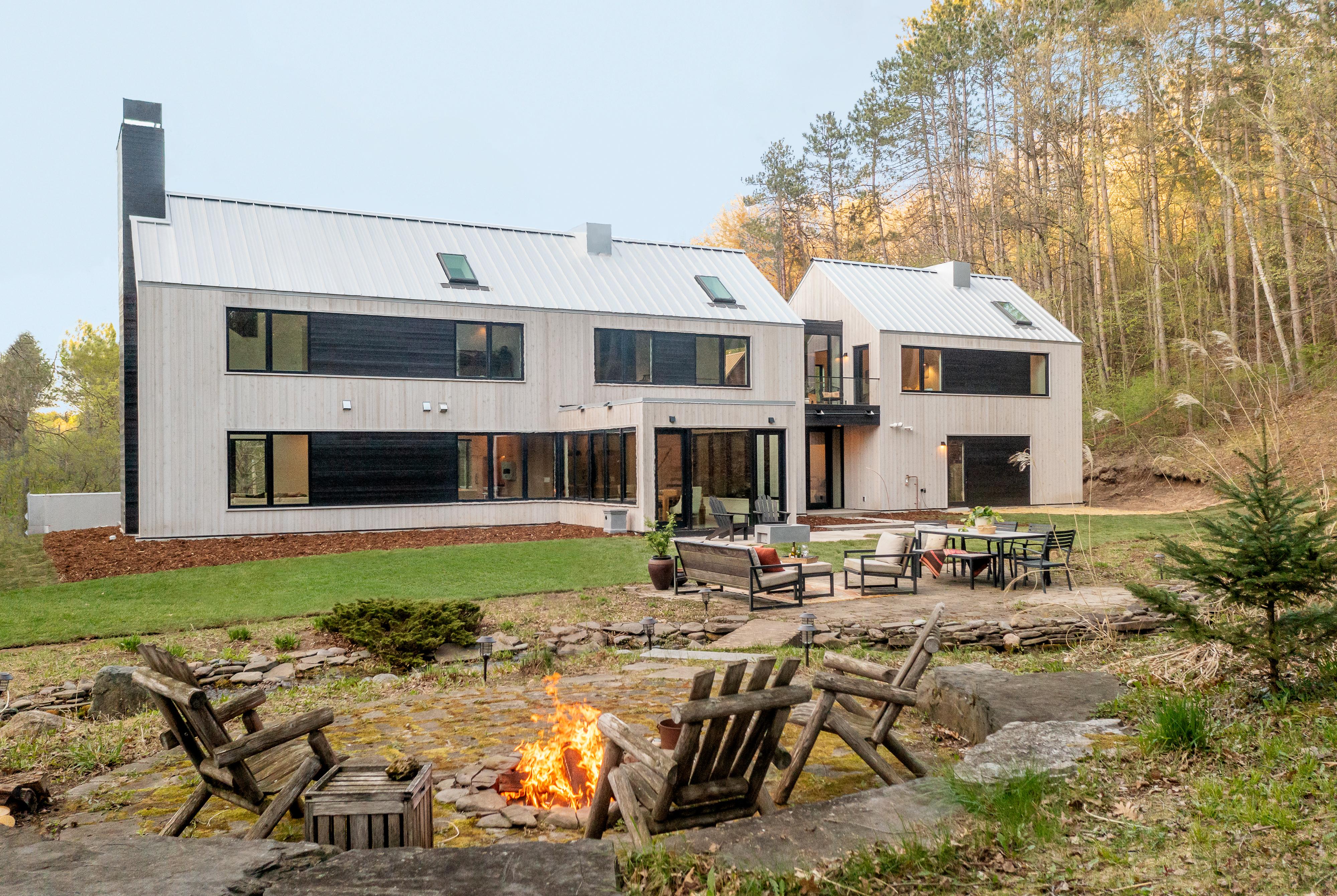 Fall 2021, Idea House, Modern Barnhouse, St. Paul, MN, exterior rear view with patio