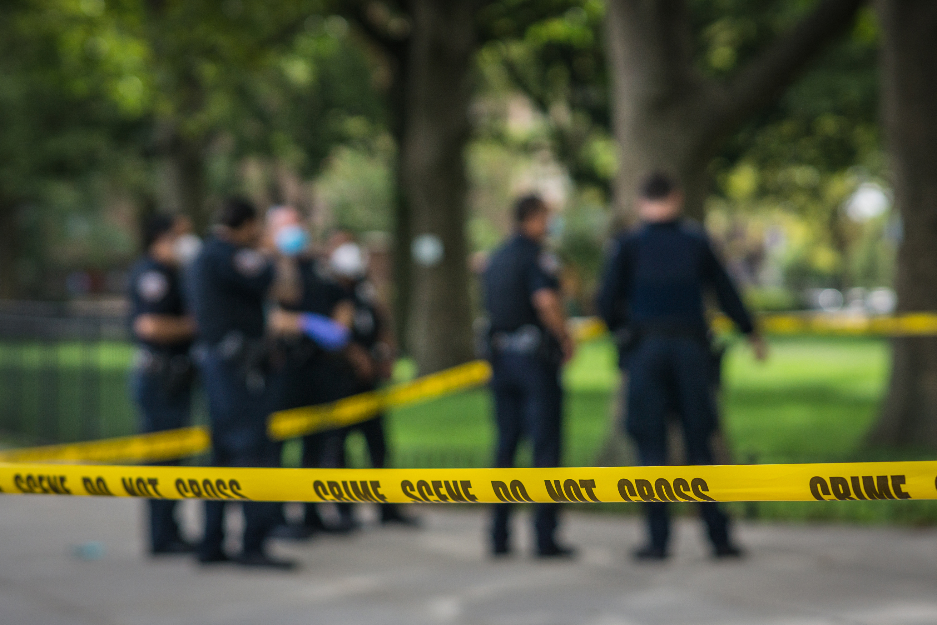 Crime scene tape surrounds police investigating a shooting in The Bronx, Sept. 13, 2020.