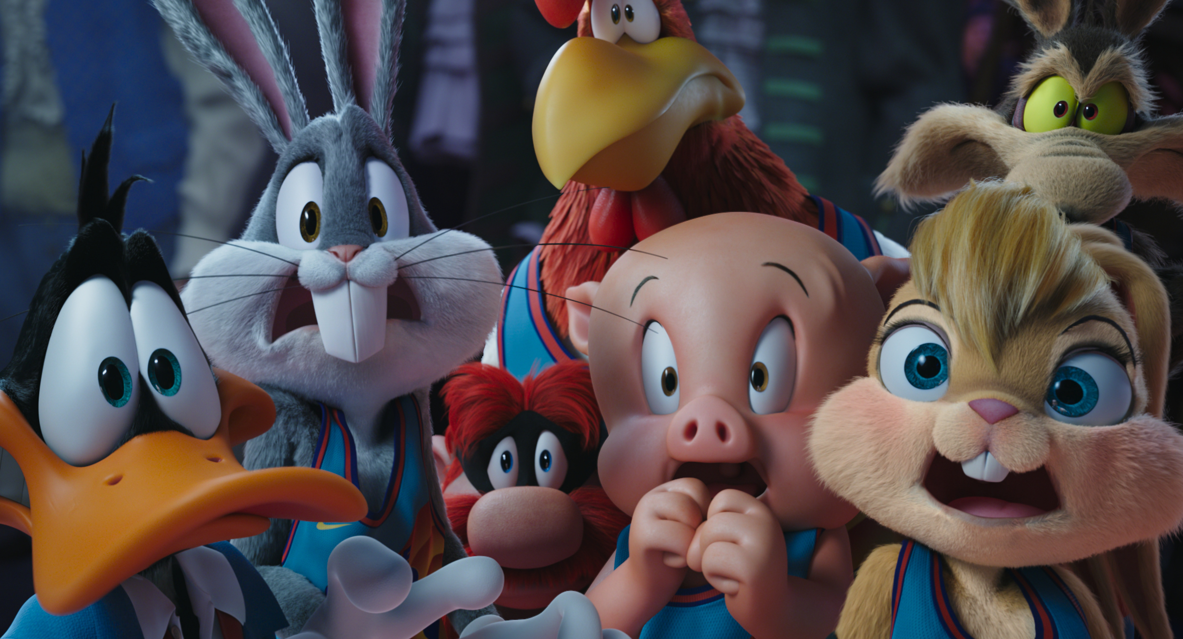 DAFFY DUCK, BUGS BUNNY, YOSEMITE SAM, FOGHORN LEGHORN, PORKY PIG, LOLA BUNNY and WILE E. COYOTE in Space Jam: A New Legacy. They look scared.