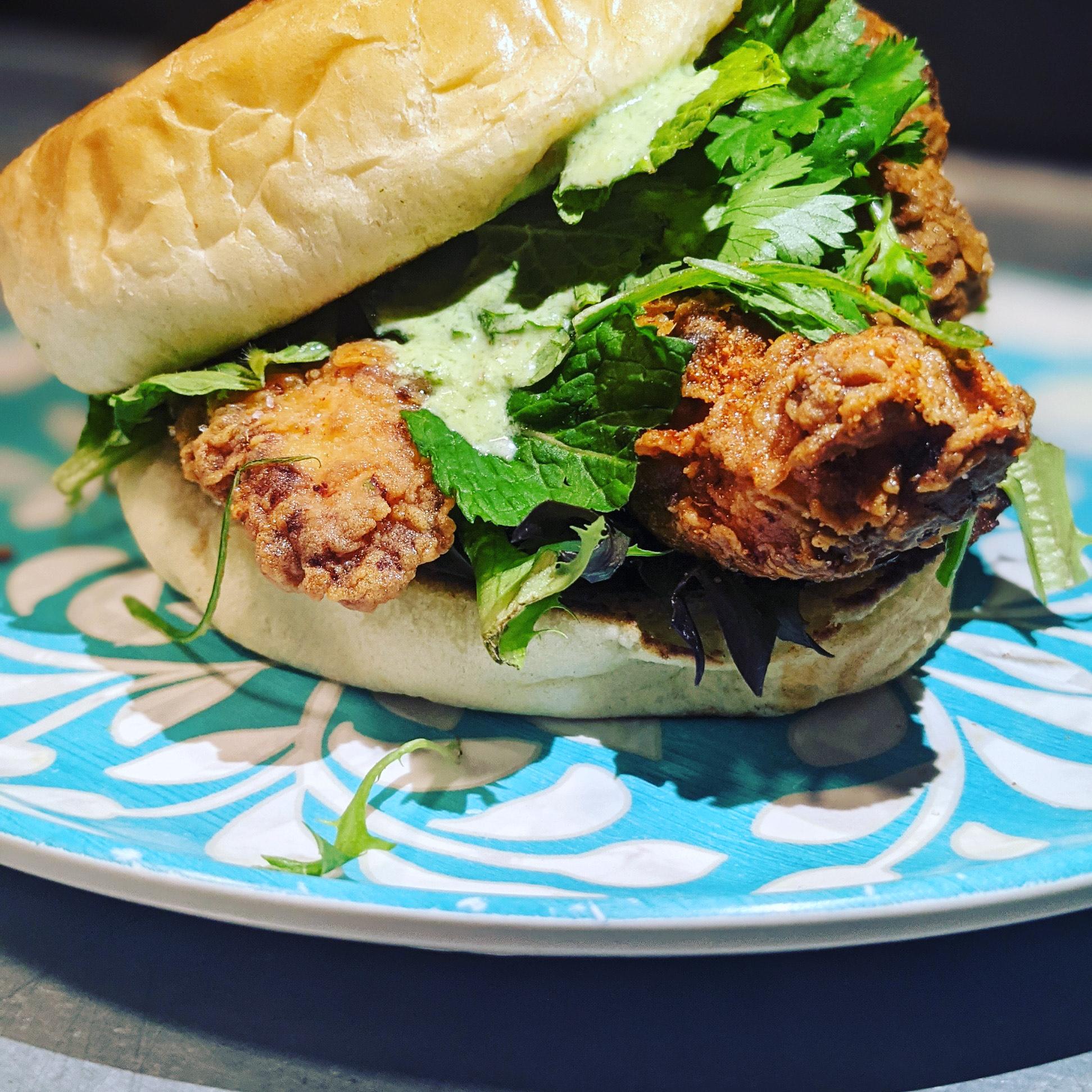 A fried chicken sando on a bun.