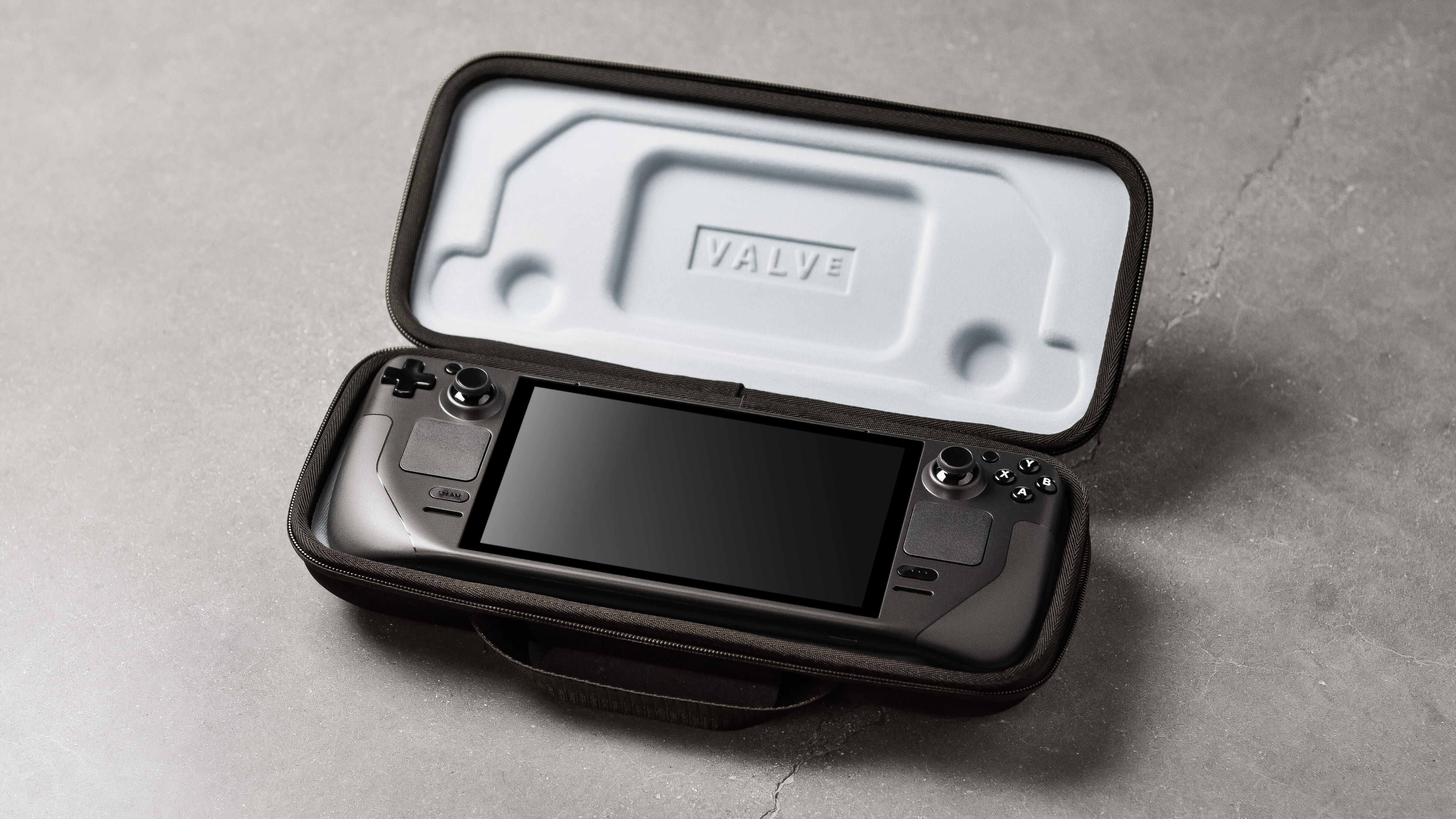 a photo of a Steam Deck, a new handheld console from Valve, in a case