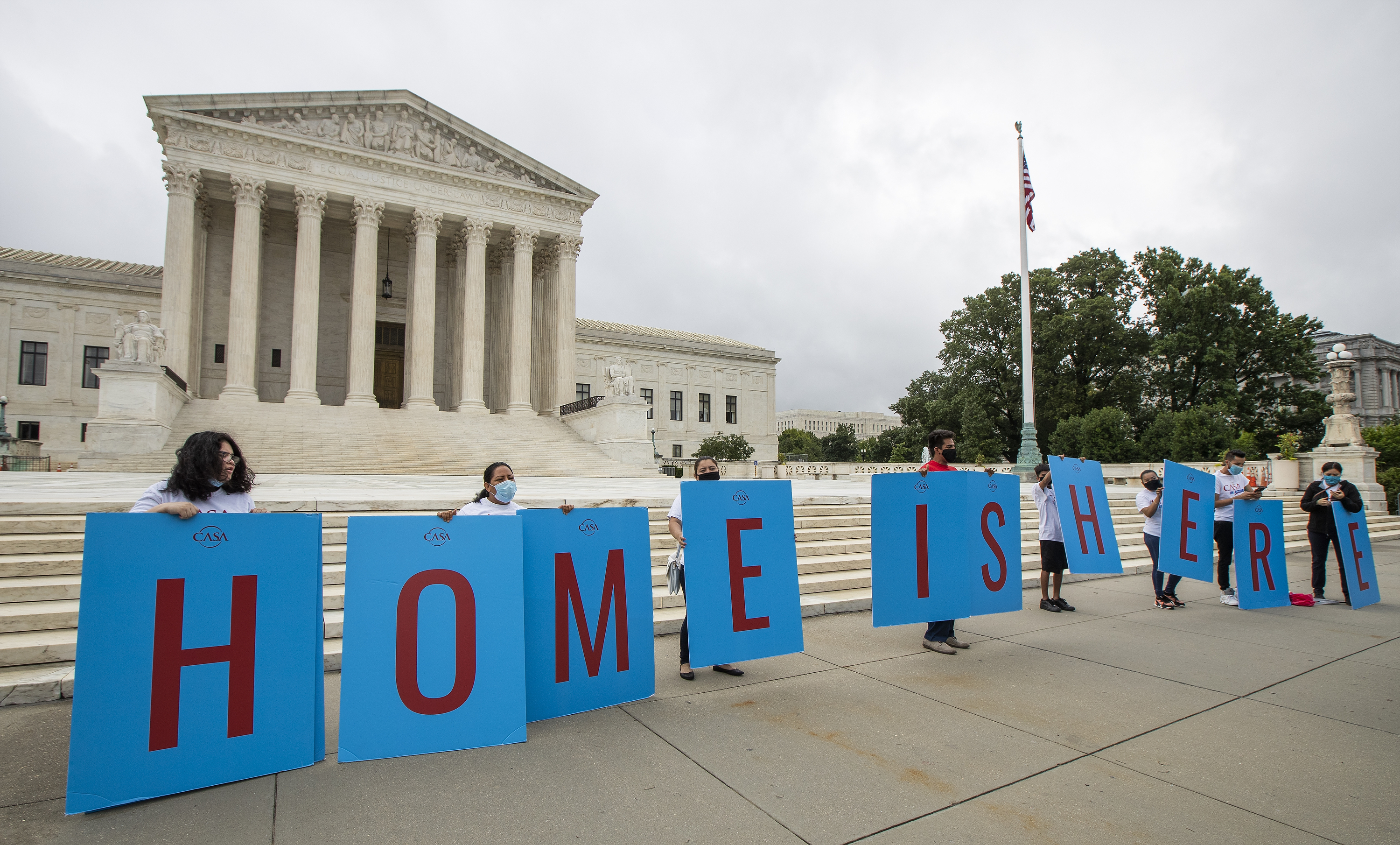 In this June 18, 2020, file photo, Deferred Action for Childhood Arrivals (DACA) students gather in front of the Supreme Court in Washington.