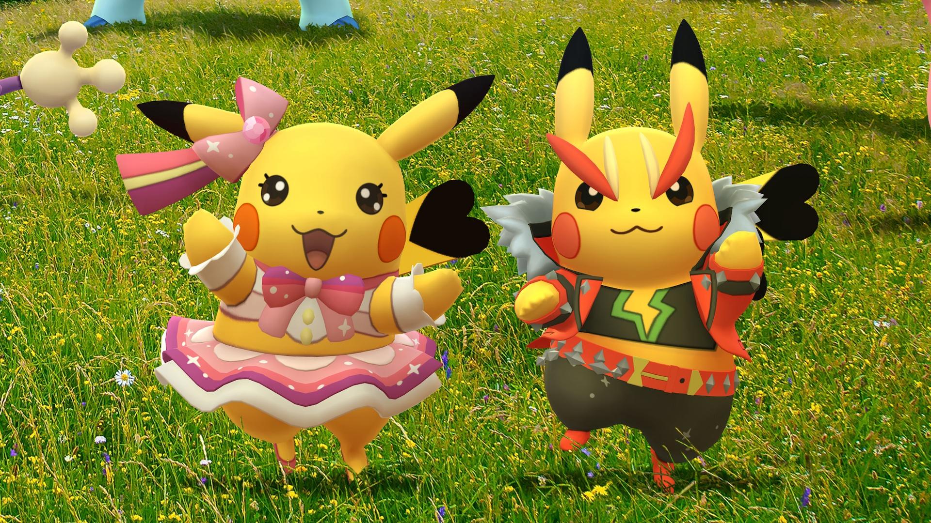 Pikachu Pop Star and Pikachu Rock Star dance in a field in artwork for Pokémon Go Fest 2021