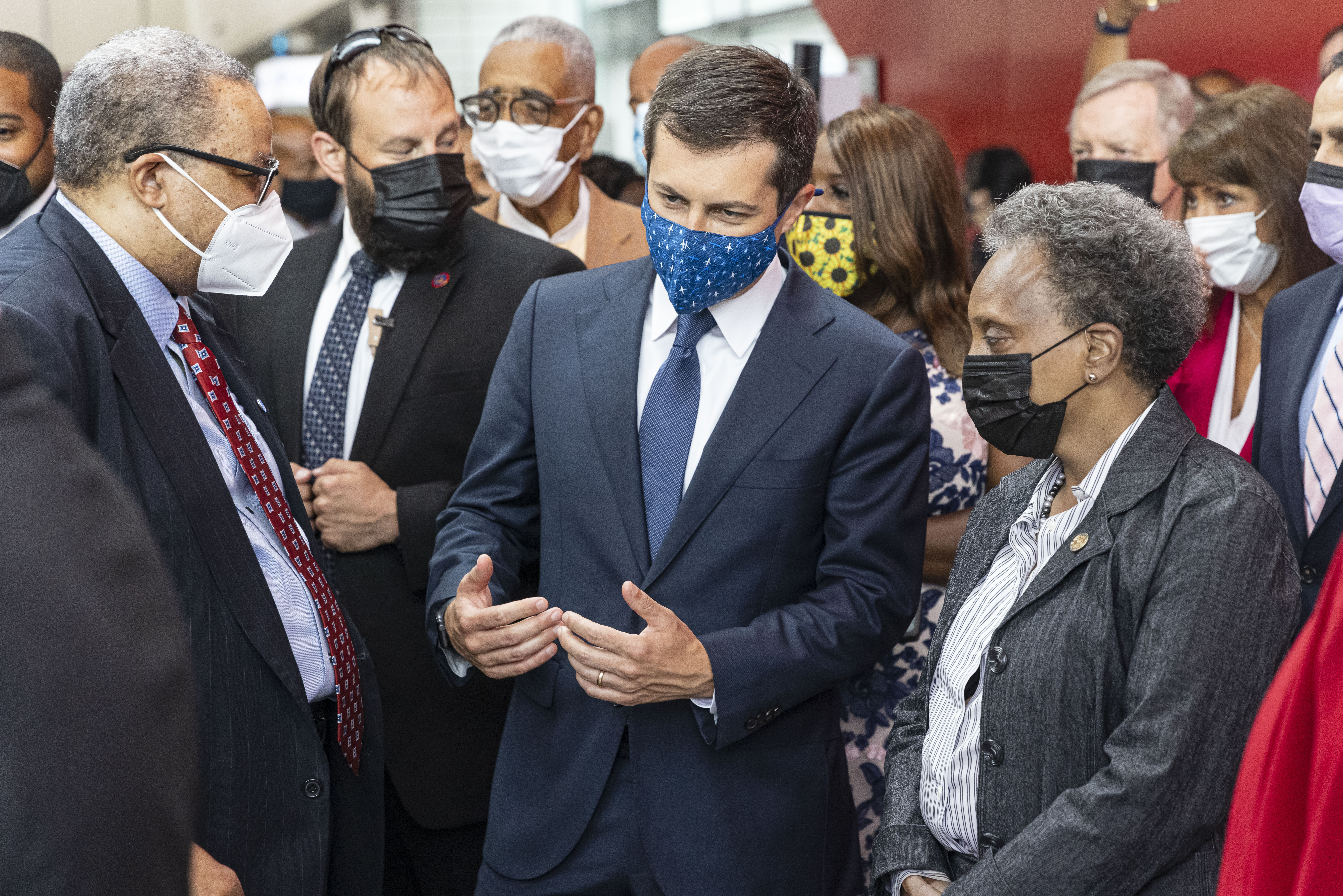U.S. Transportation Secretary Pete Buttigieg speaks with Mayor Lori Lightfoot and CTA President Dorval R. Carter, Jr. during a tour of the CTA Red Line 95th St/ Dan Ryan Station on Friday.