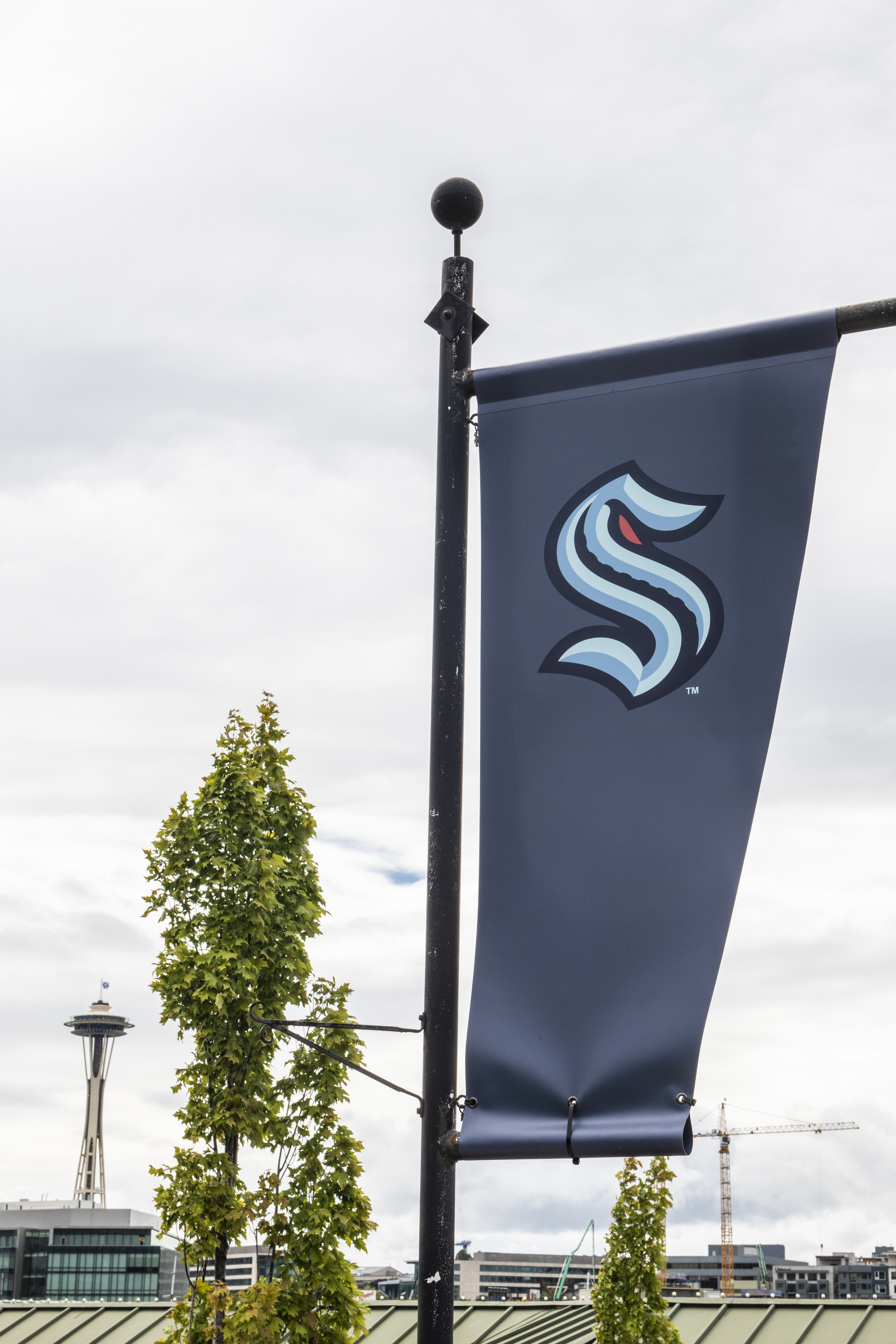 The NHL's newest franchise Seattle Kraken flies a flag outside its Team Store with the Space Needle in the background on August 21, 2020 in Seattle, Washington.