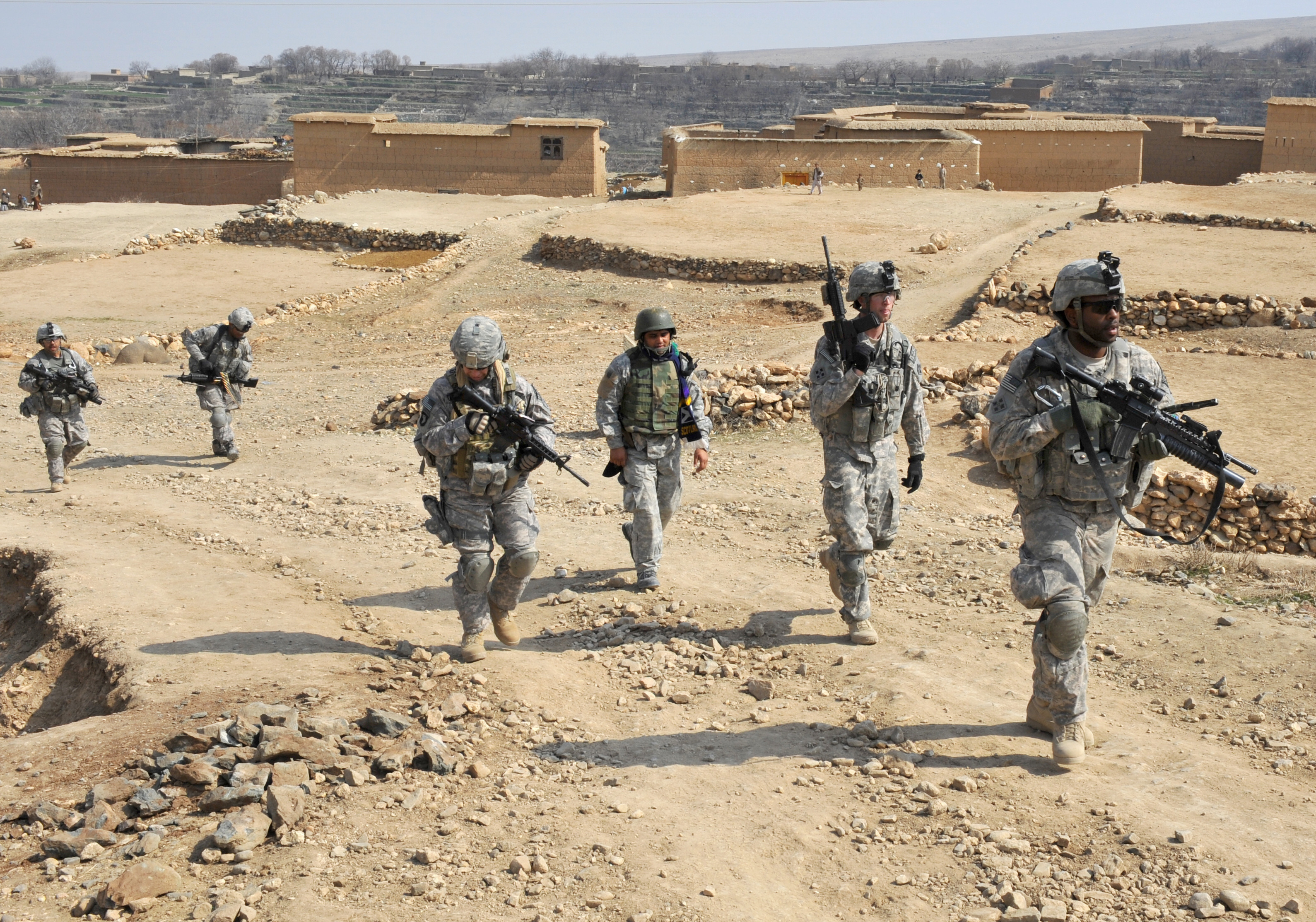 Five US soldiers patrol with an Afghan interpreter