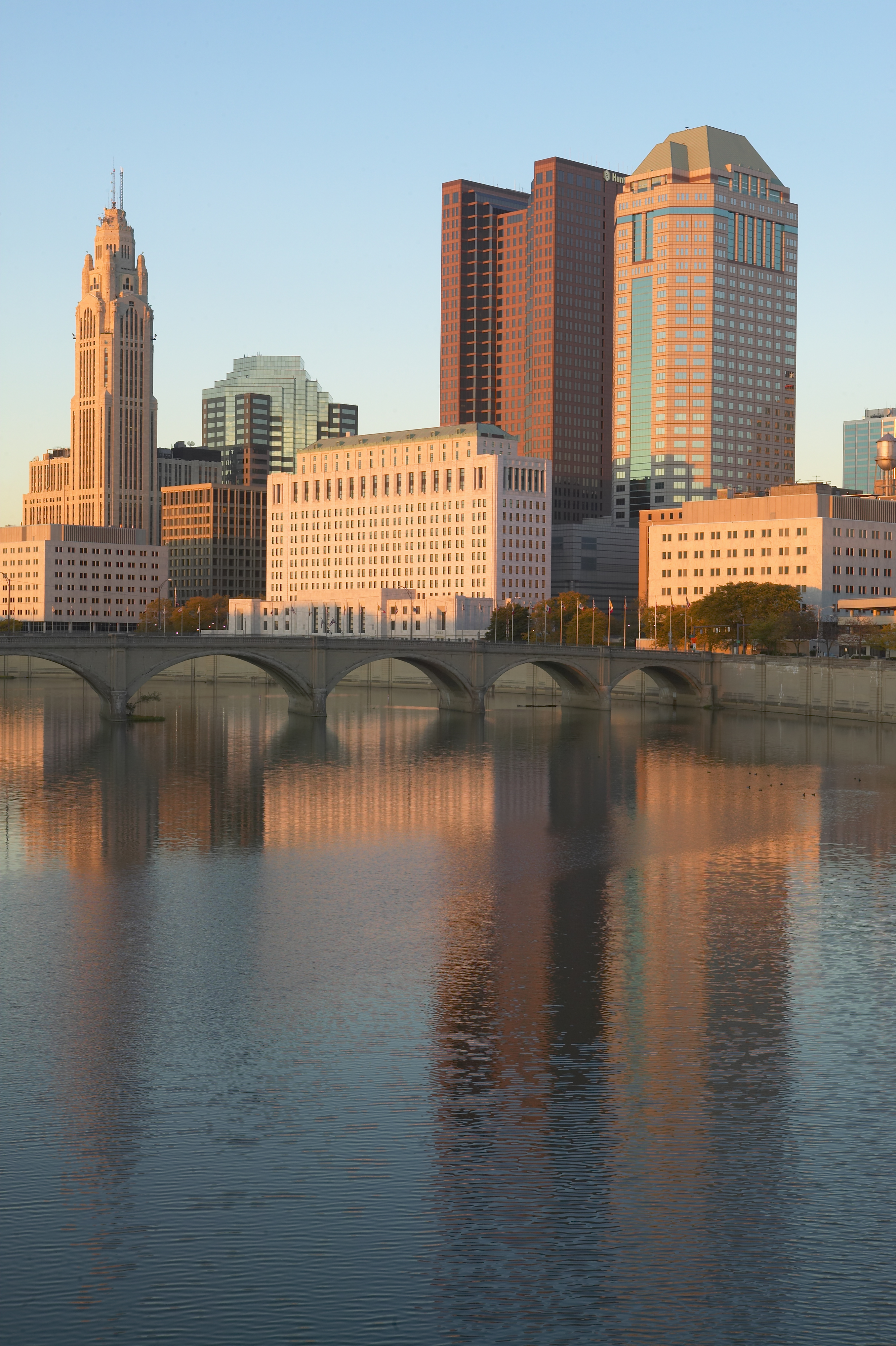 Scioto River and Columbus Ohio skyline in autumn with sunset reflection in water