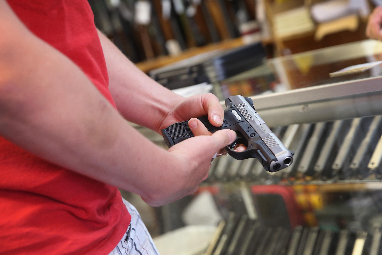 A customer checks out a gun at a suburban gun store.