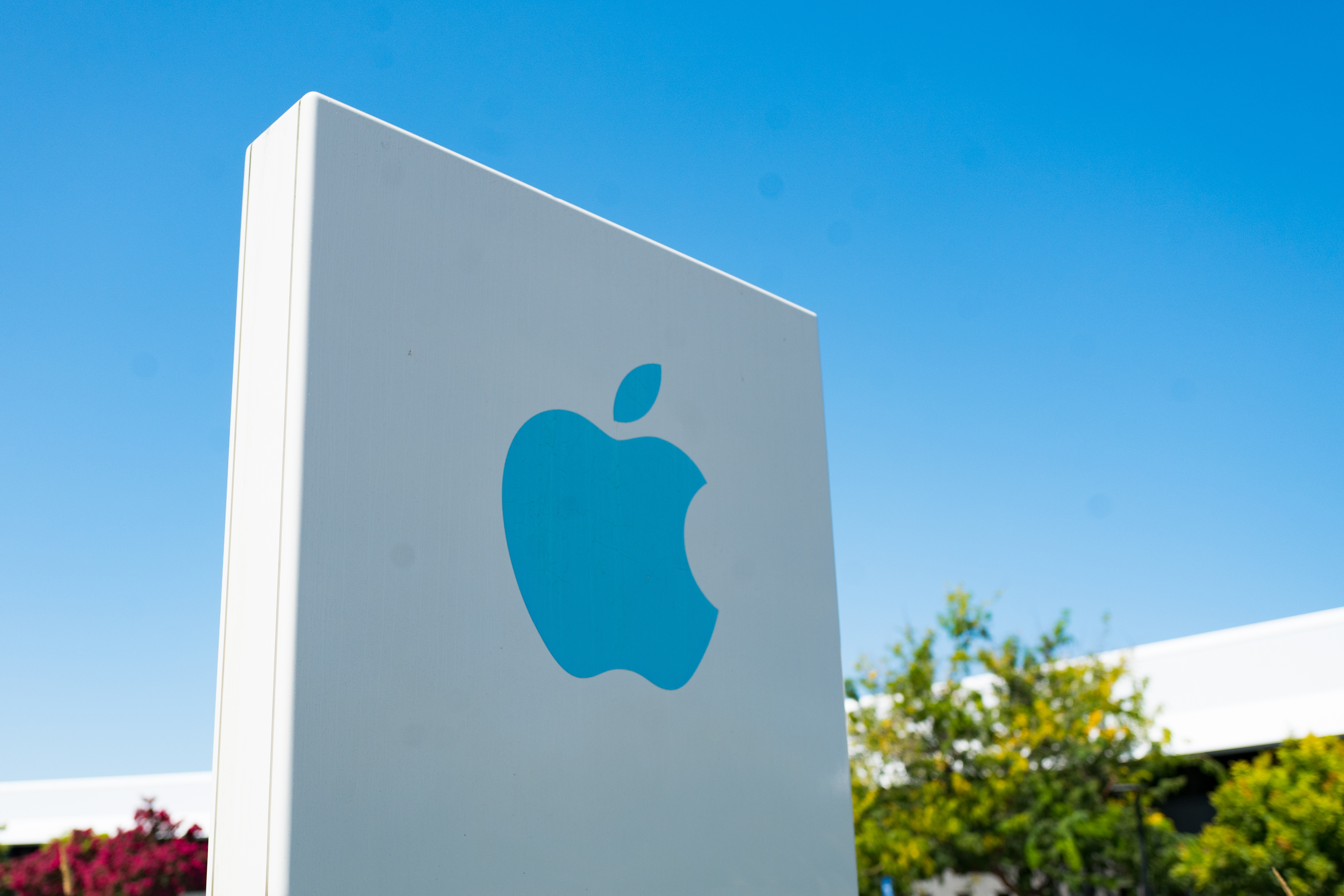 A sign outside of one of Apple's offices in Silicon Valley is a white square with a blue Apple logo.