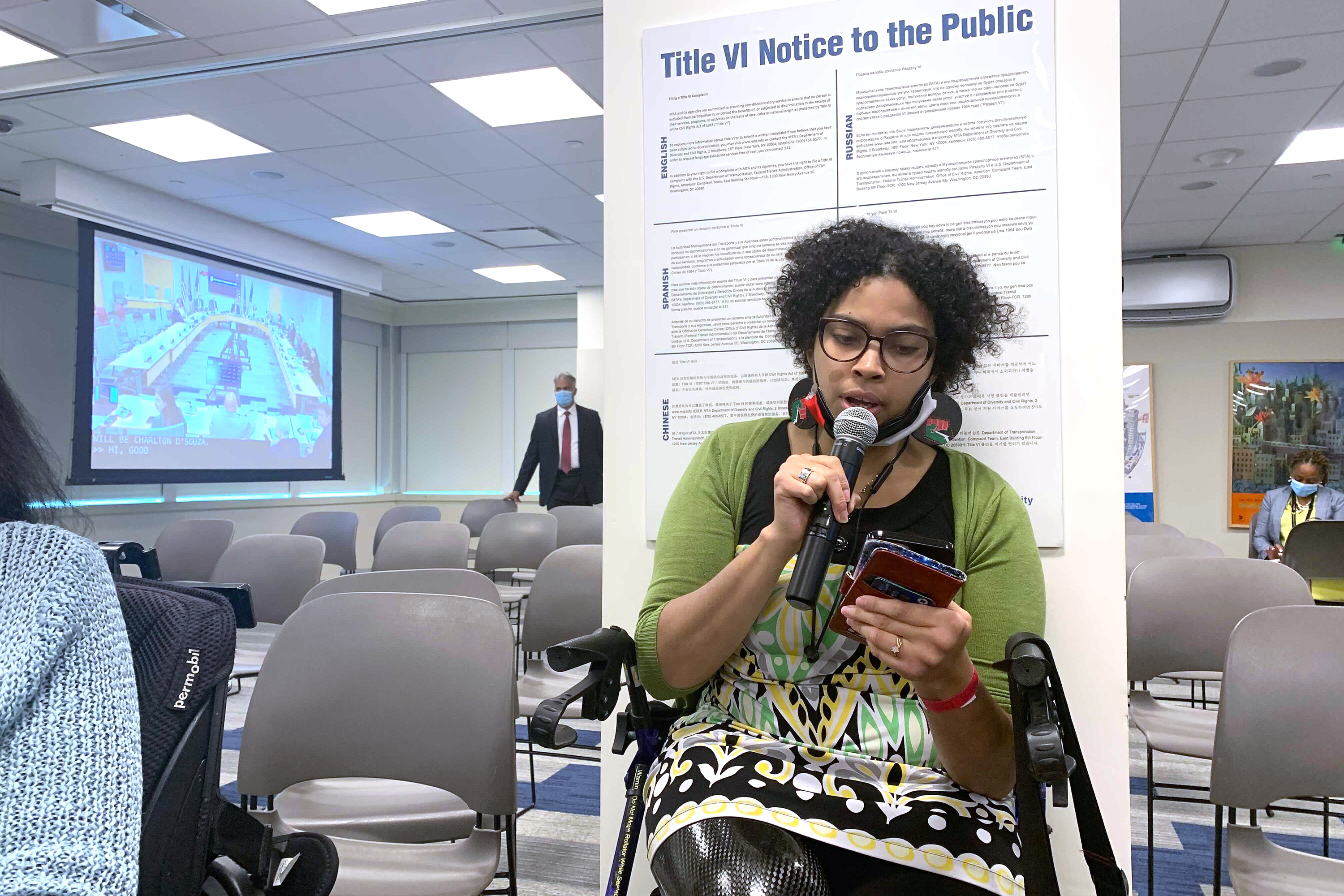 Eman Rimawi, an Access-A-Ride campaign coordinator for New York Lawyers for the Public Interest, speaks at an MTA committee meeting in Manhattan on July 19, 2021.