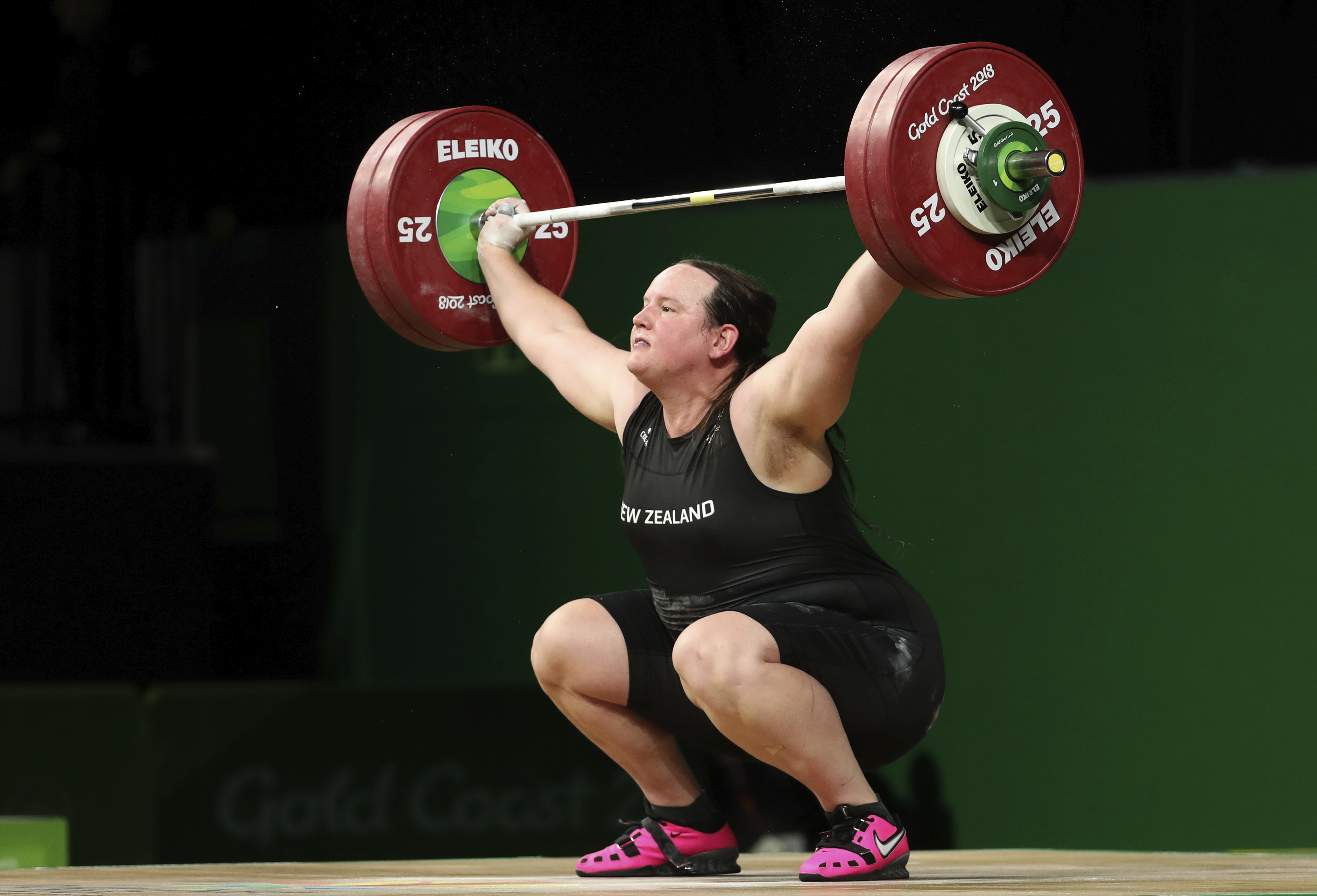 In this April 9, 2018 file photo, New Zealand's Laurel Hubbard lifts in the snatch of the women's +90kg weightlifting final at the 2018 Commonwealth Games on the Gold Coast, Australia. Hubbard will be the first transgender athlete to compete at the Olympics. Hubbard is among five athletes confirmed on New Zealand's weightlifting team for the Tokyo Games.