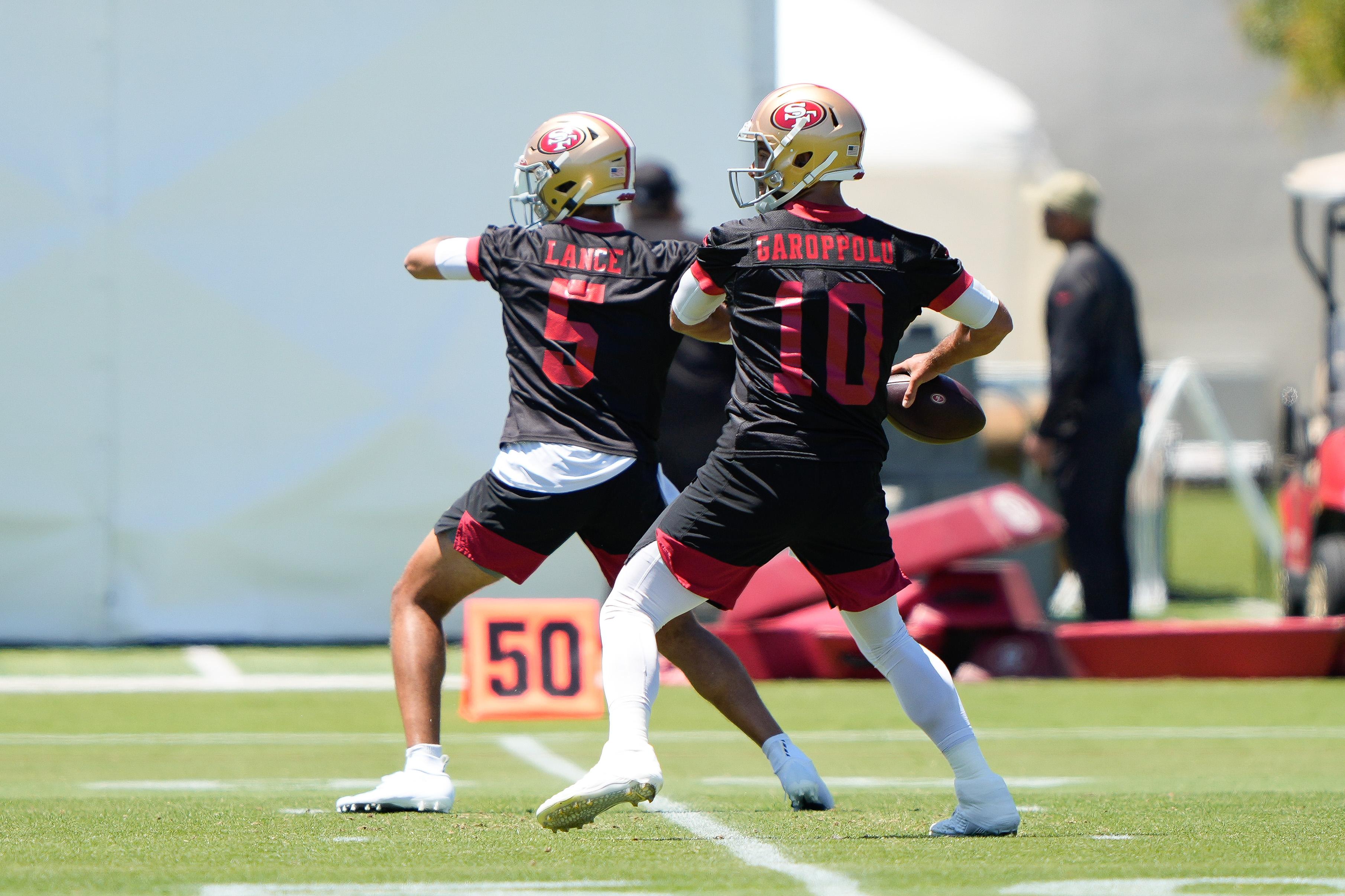 San Francisco 49ers quarterbacks Trey Lance (5) and Jimmy Garoppolo (10) throw the football during Organized Team Activities at San Francisco 49ers Training Facility.