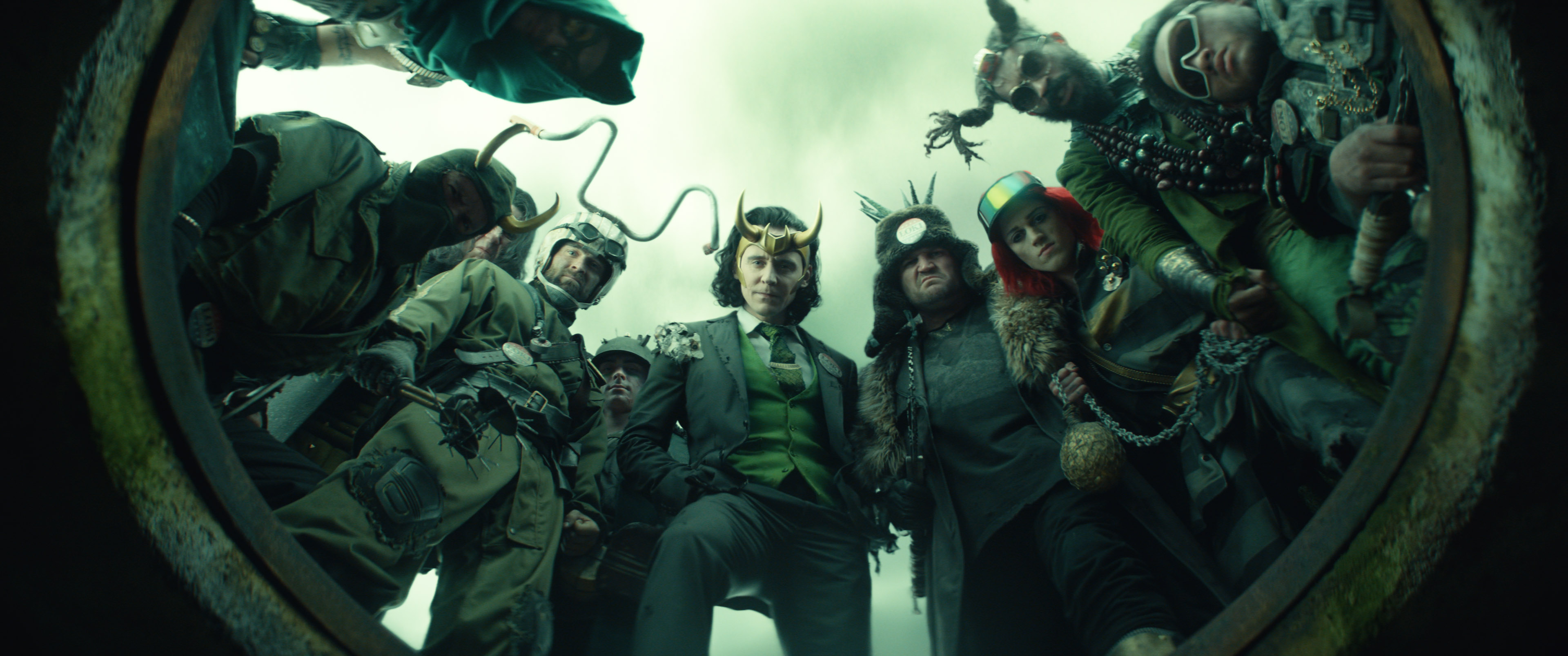 A whole buncha Lokis, centered on President Loki, look down at the camera in episode 5 of Loki