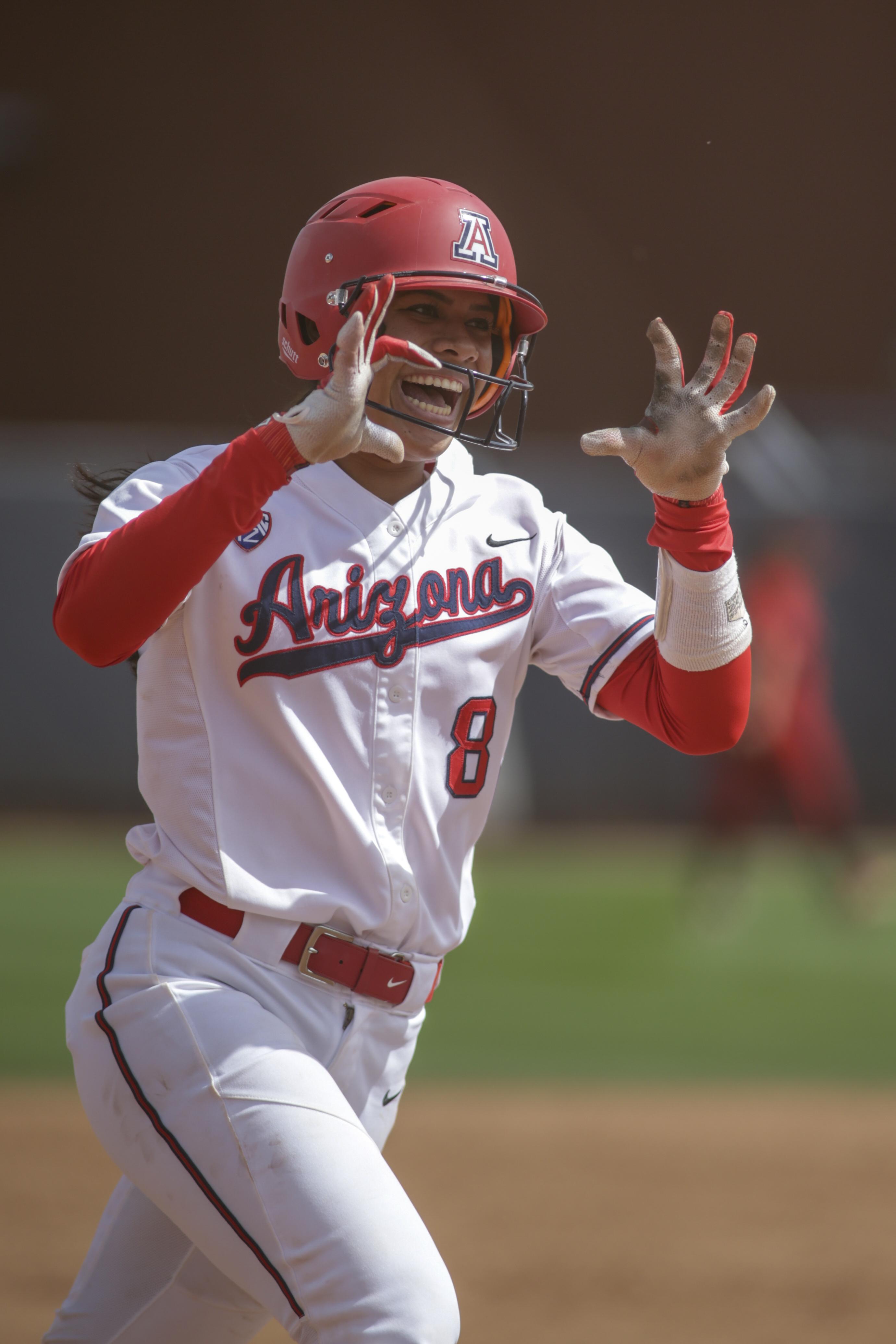Dejah Mulipola runs the bases after hitting a homer.