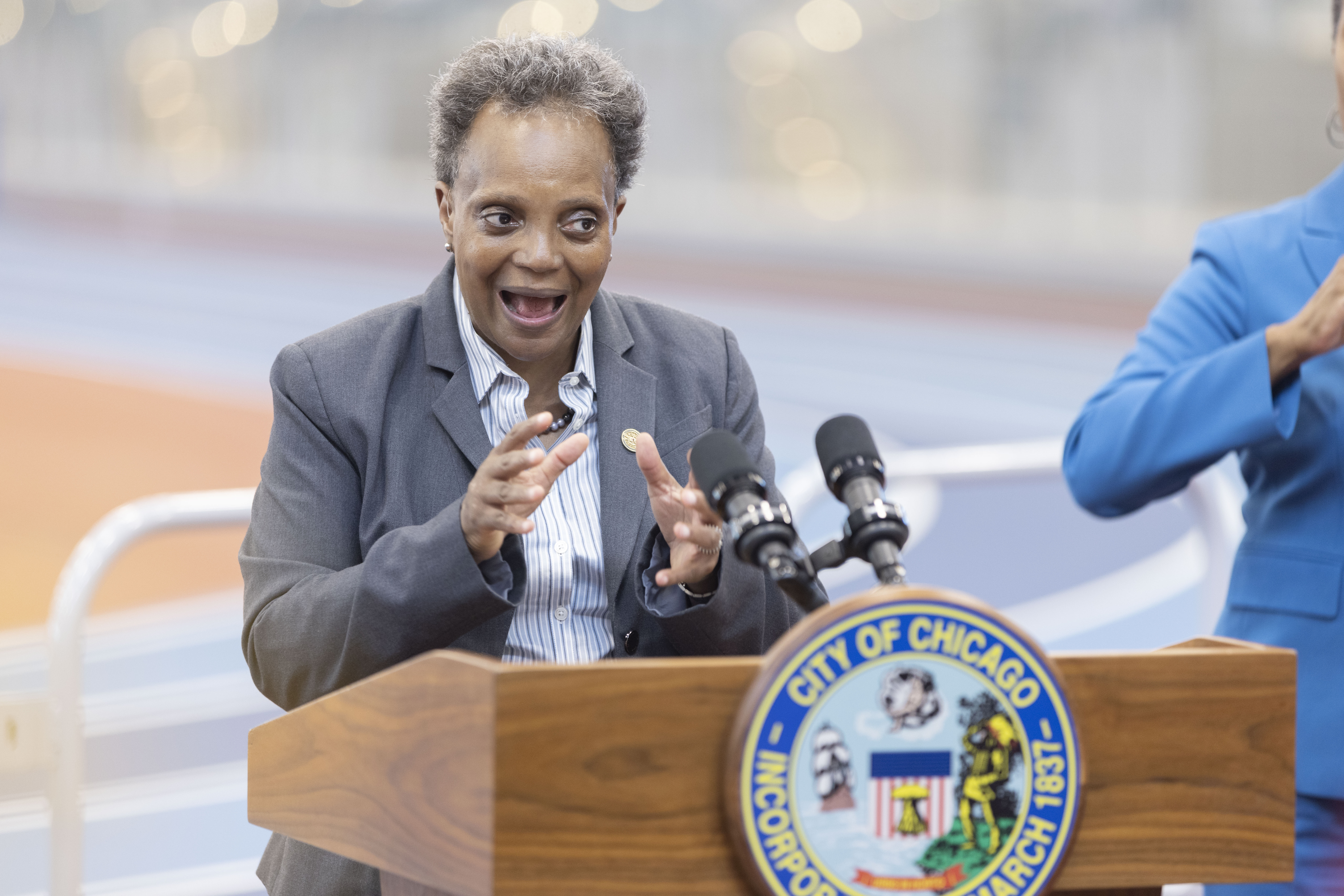 Mayor Lori Lightfoot, pictured at a July 6 news conference, urged residents on Tuesday to get a COVID-19 shot as cases swing upward again.