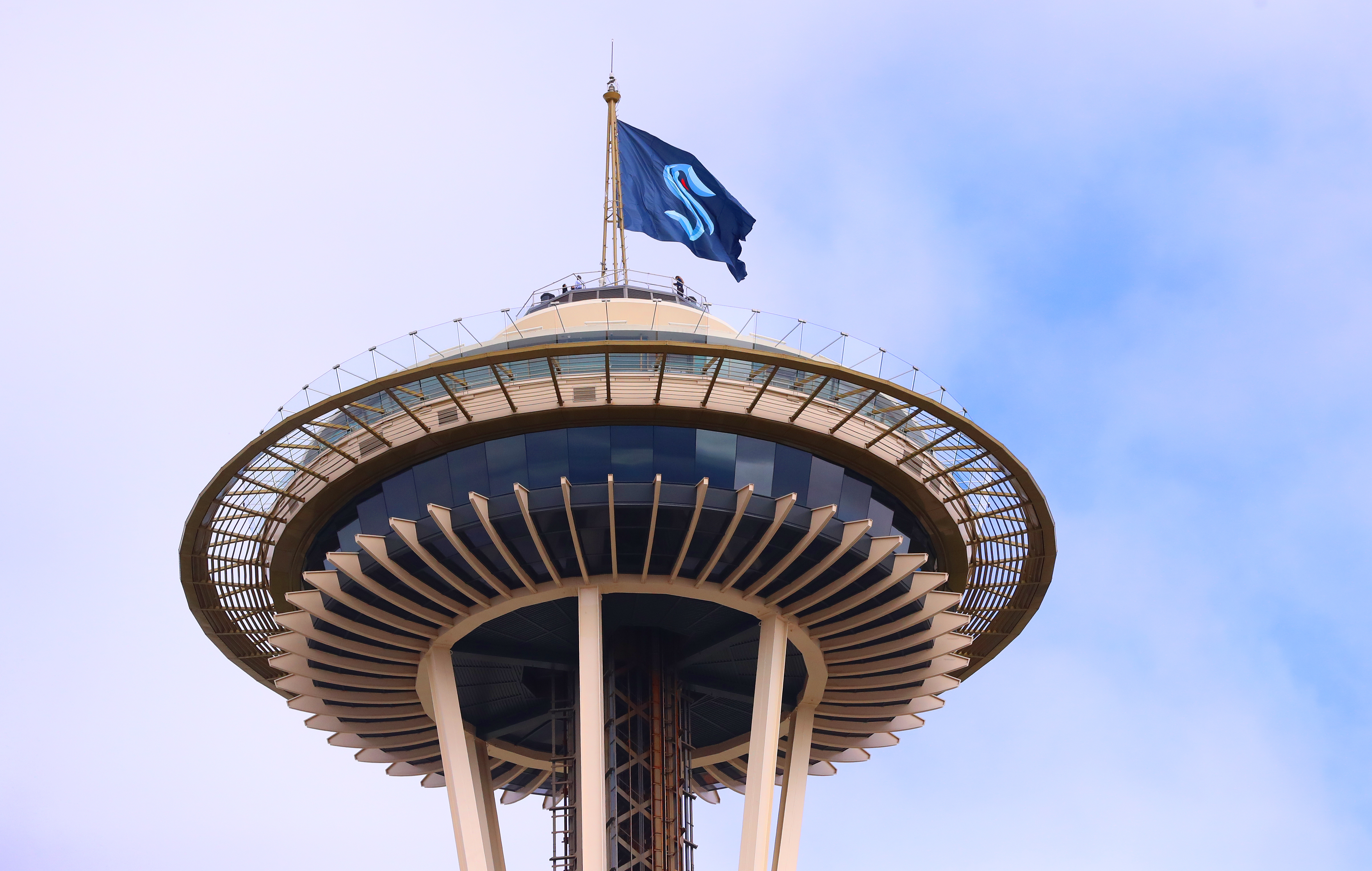 A flag with the Seattle Kraken logo flies on top of the Space Needle.