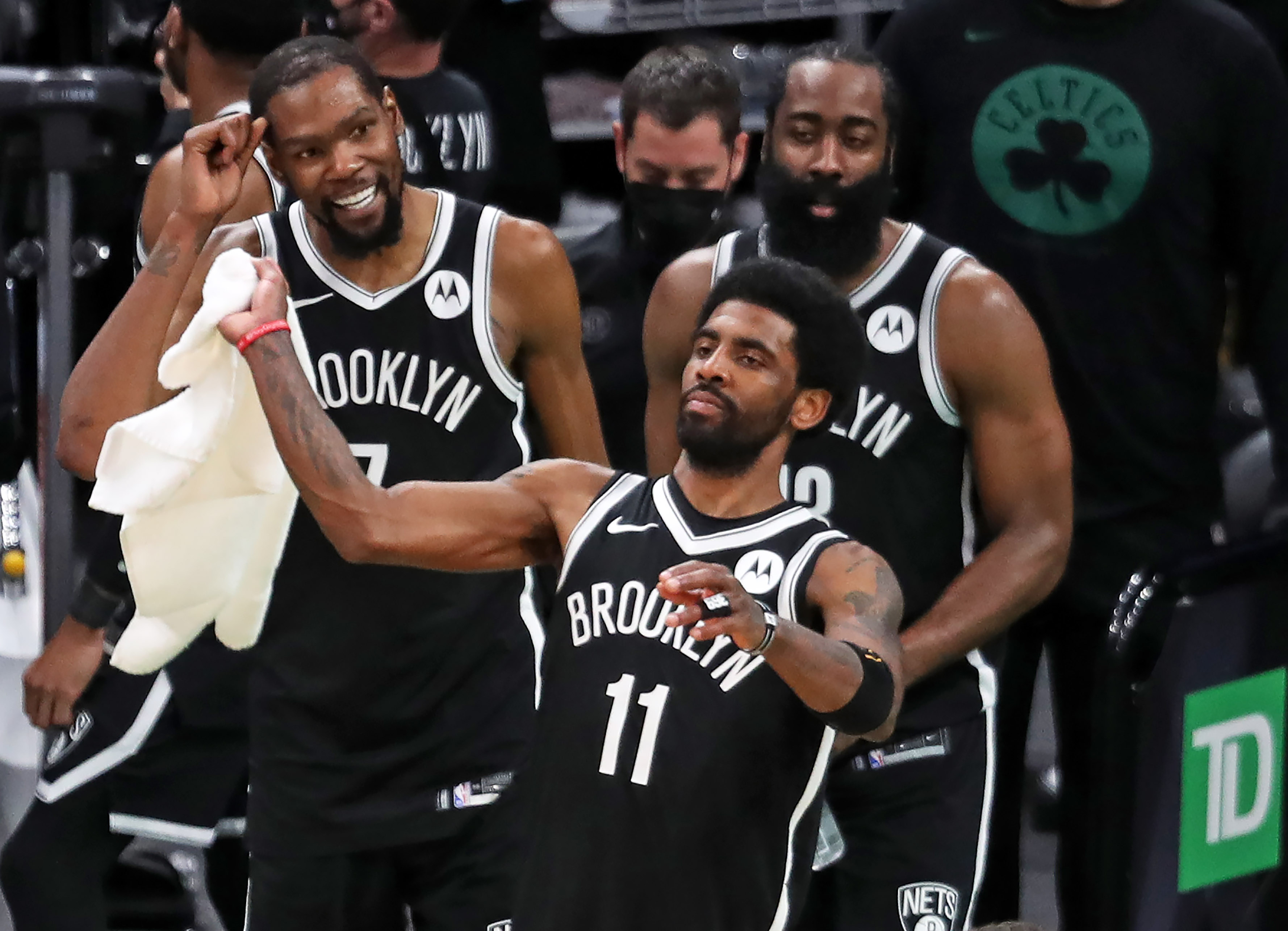 The Nets Kyrie Irving waves a towel in celebration as the final seconds ticked off the clock, his teammates Kevin Durant and James Harden are behind him. The Boston Celtics host the Brooklyn Nets in Game Four of their first round NBA Playoff series at the TD Garden in Boston on May 30, 2021.