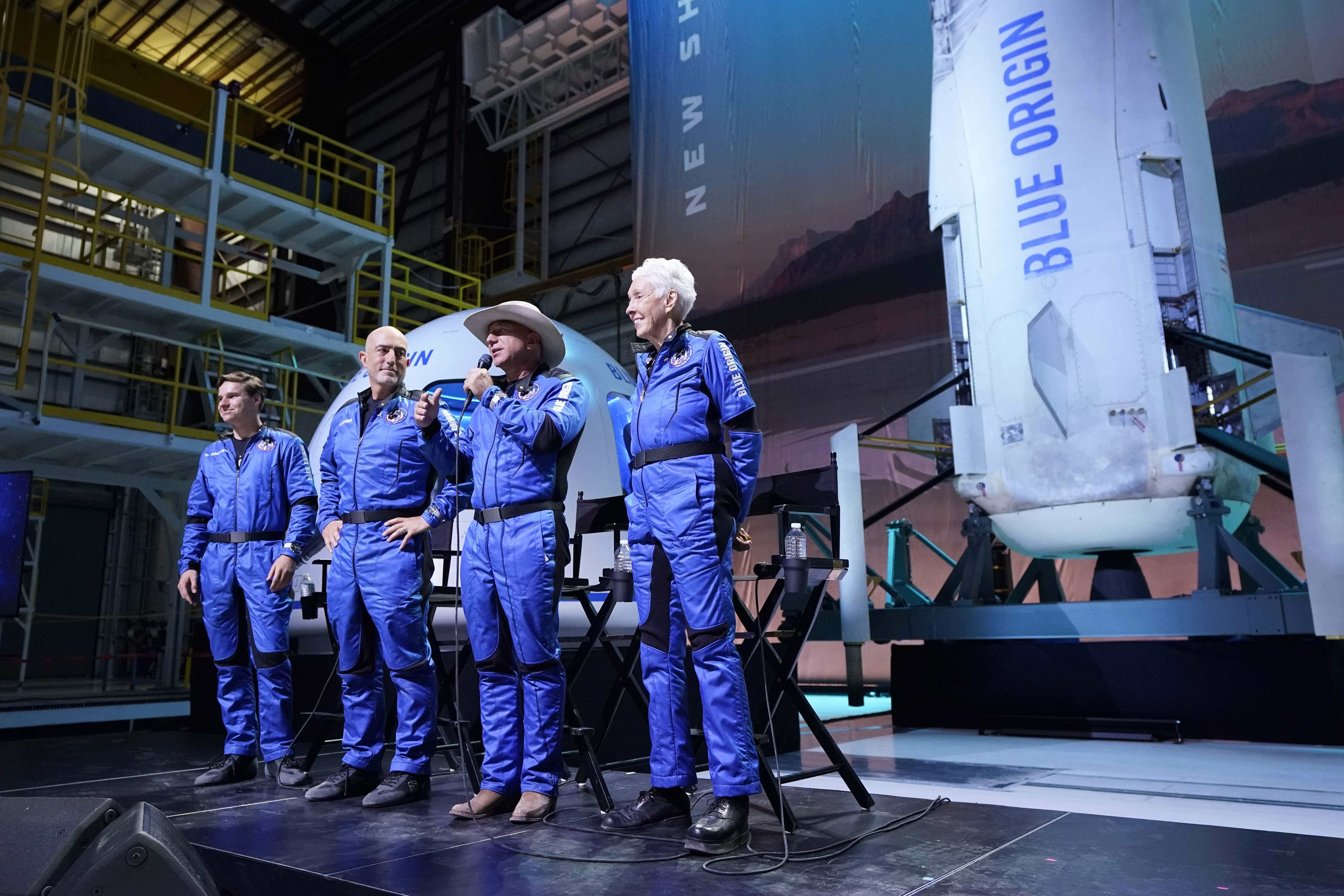 Oliver Daemen, from left, Mark Bezos, and Wally Funk, right, listen as Jeff Bezos, second from right, founder of Amazon and space tourism company Blue Origin, makes comments after their flight experience from the spaceport near Van Horn, Texas, Tuesday, July 20, 2021.