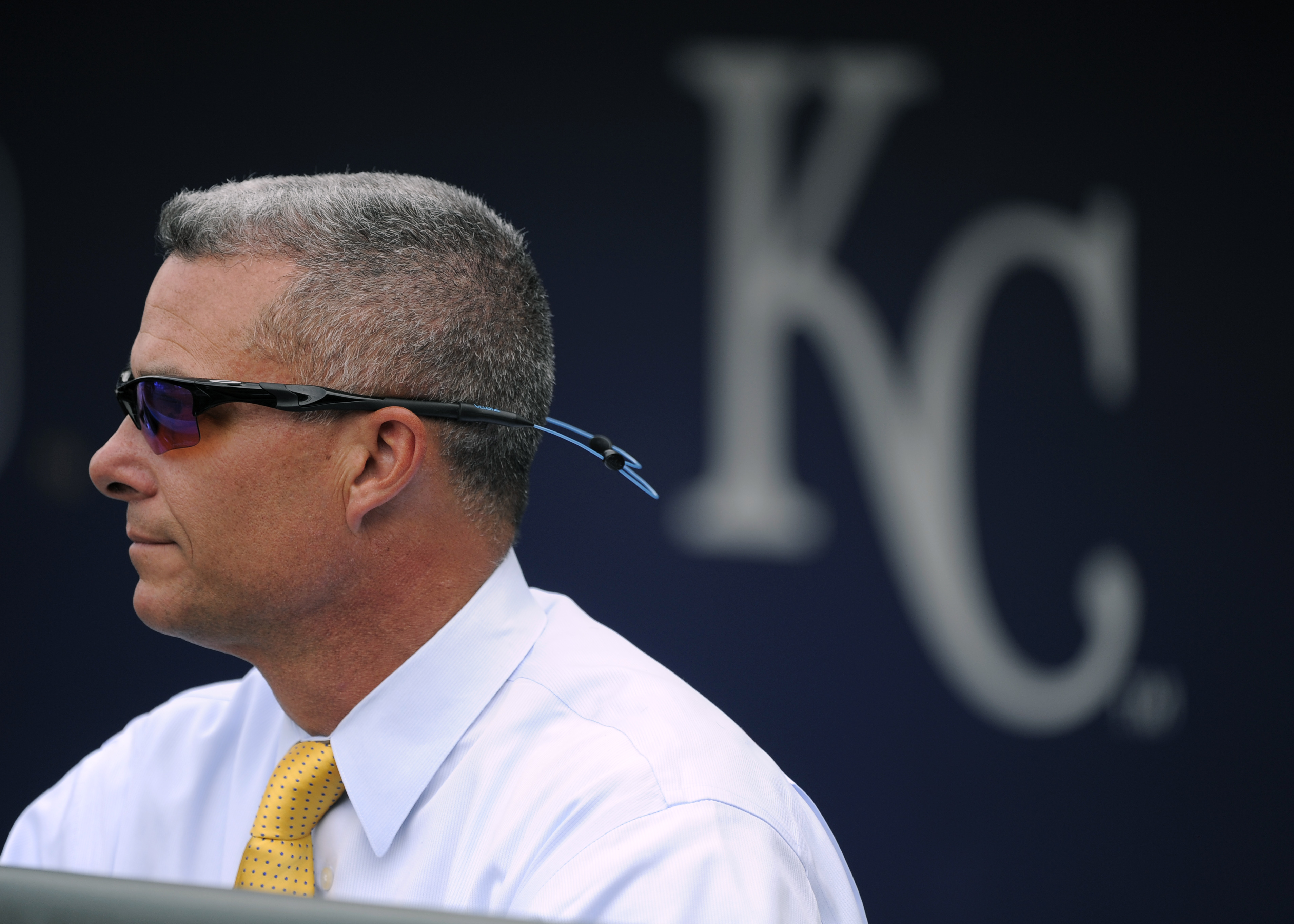 Dayton Moore, general manager of the Kansas City Royals, watches as the Royals take batting practice prior to a game against the Detroit Tigers on May 1, 2015 at Kauffman Stadium in Kansas City, Missouri.