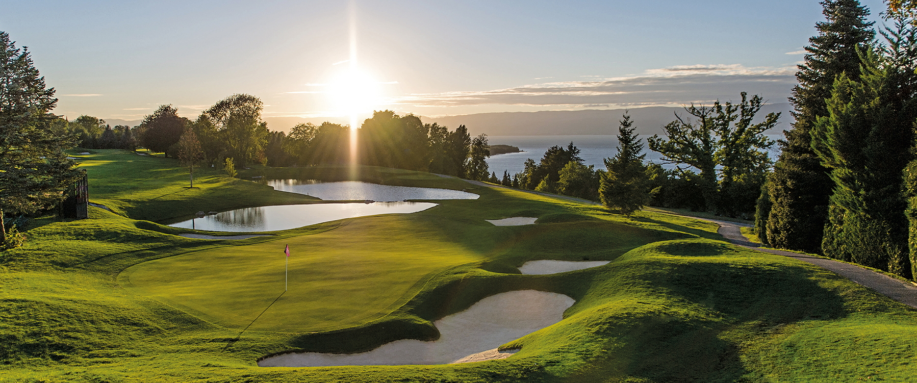 The sun setting over a golf green in EA Sports PGA Tour