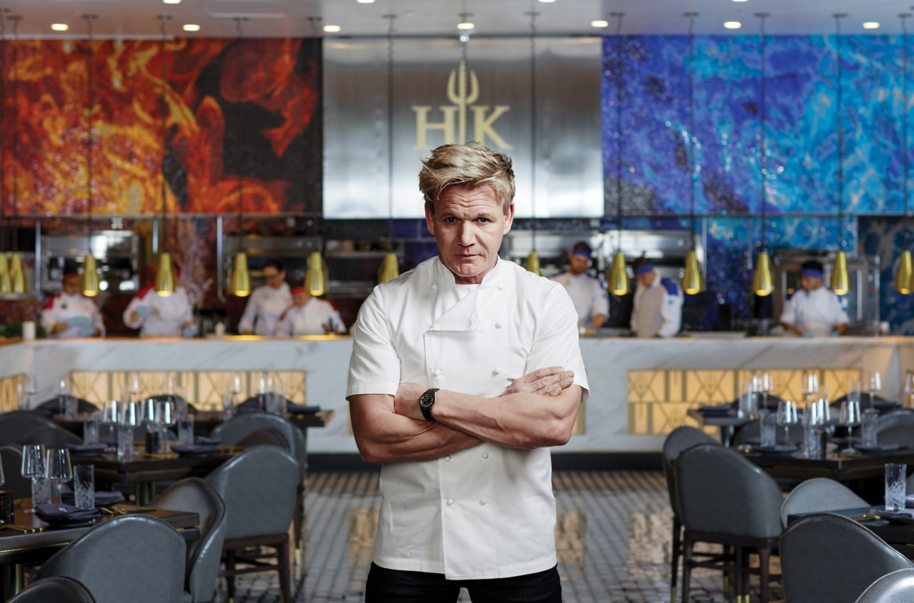 Chef Gordon Ramsay stands in front of the kitchen at his Hell's Kitchen restaurant