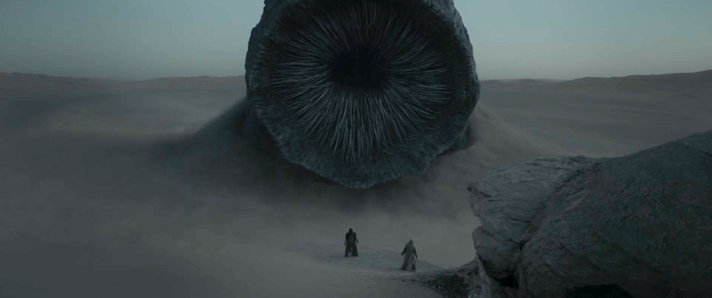 The sandworm from Dune 2020 popping out of Arakkis