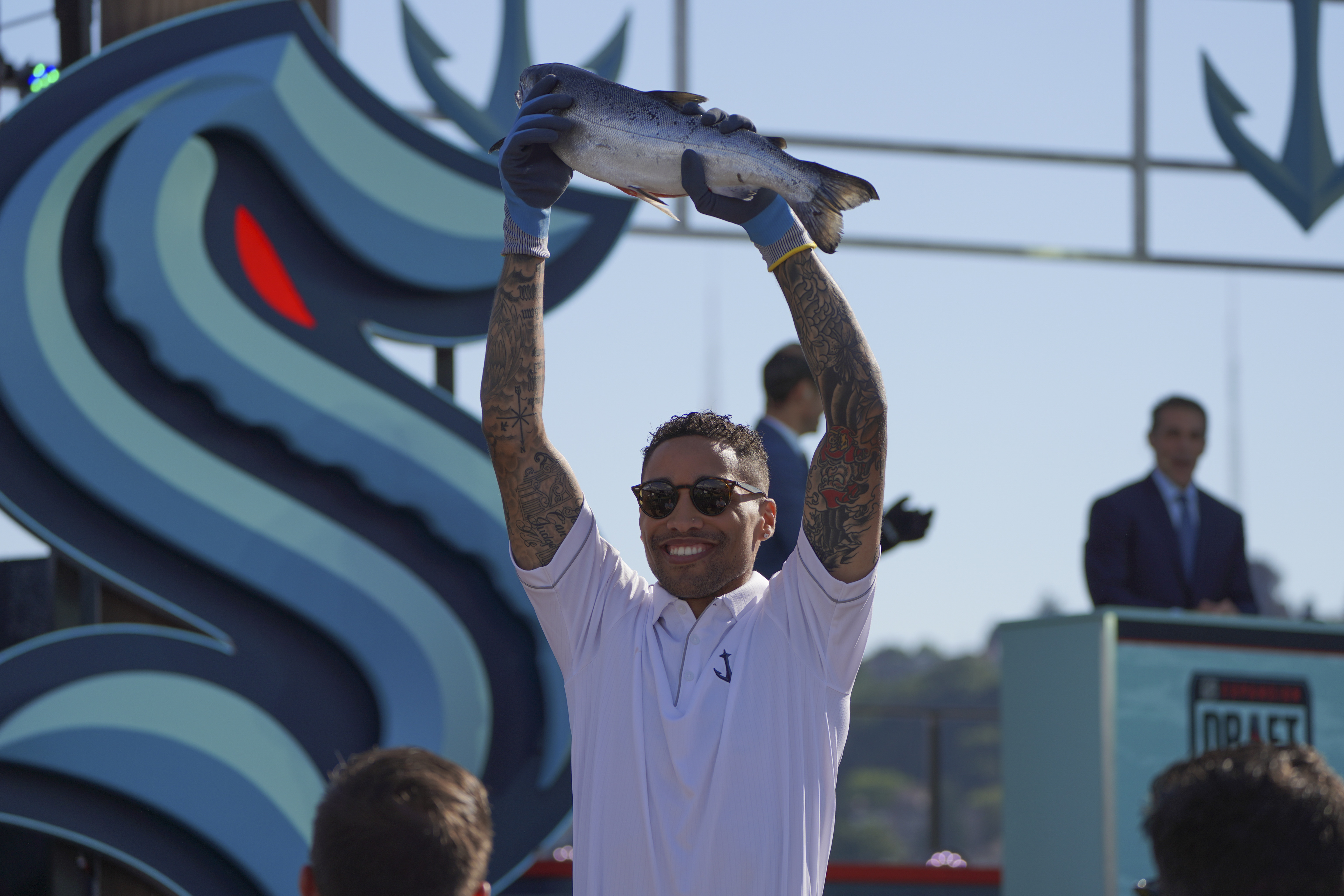 The Seattle Kraken TV color analyst JT Brown shows off his nice catch of a Pike Place Market salmon during the NHL-Seattle Kraken expansion draft July 21, 2021 at Gas Works Park in Seattle, WA