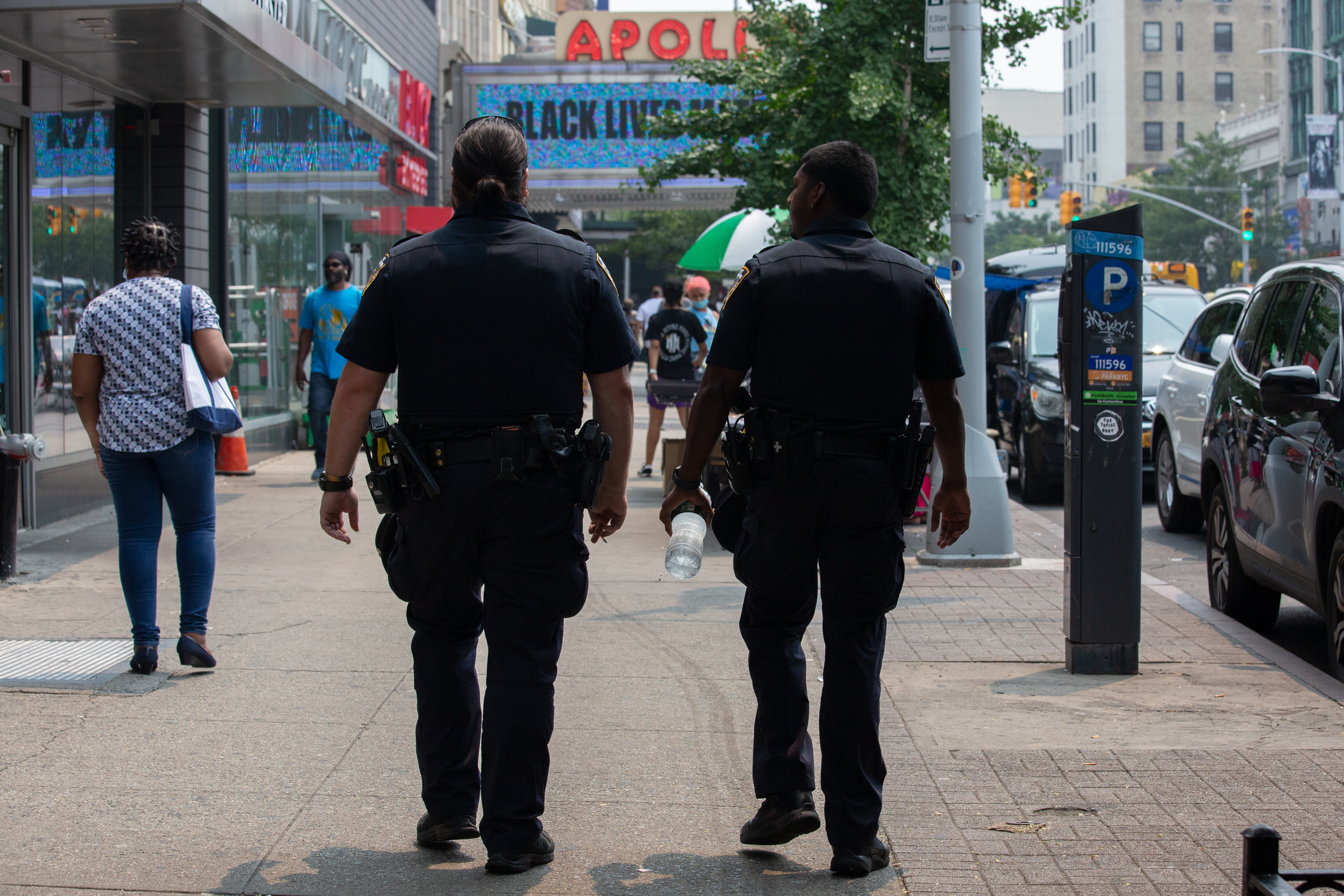 NYPD officers patrol 125th Street in Harlem, July 20, 2021.
