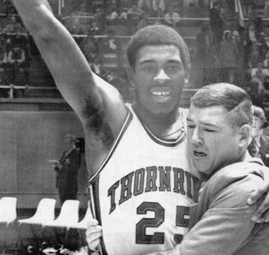 Thornridge coach Ron Ferguson and Quinn Buckner celebrate winning the 1972 Illinois high school basketball state championship. Ferguson, who went on to become athletic director at Bradley University, died Thursday at age 89.