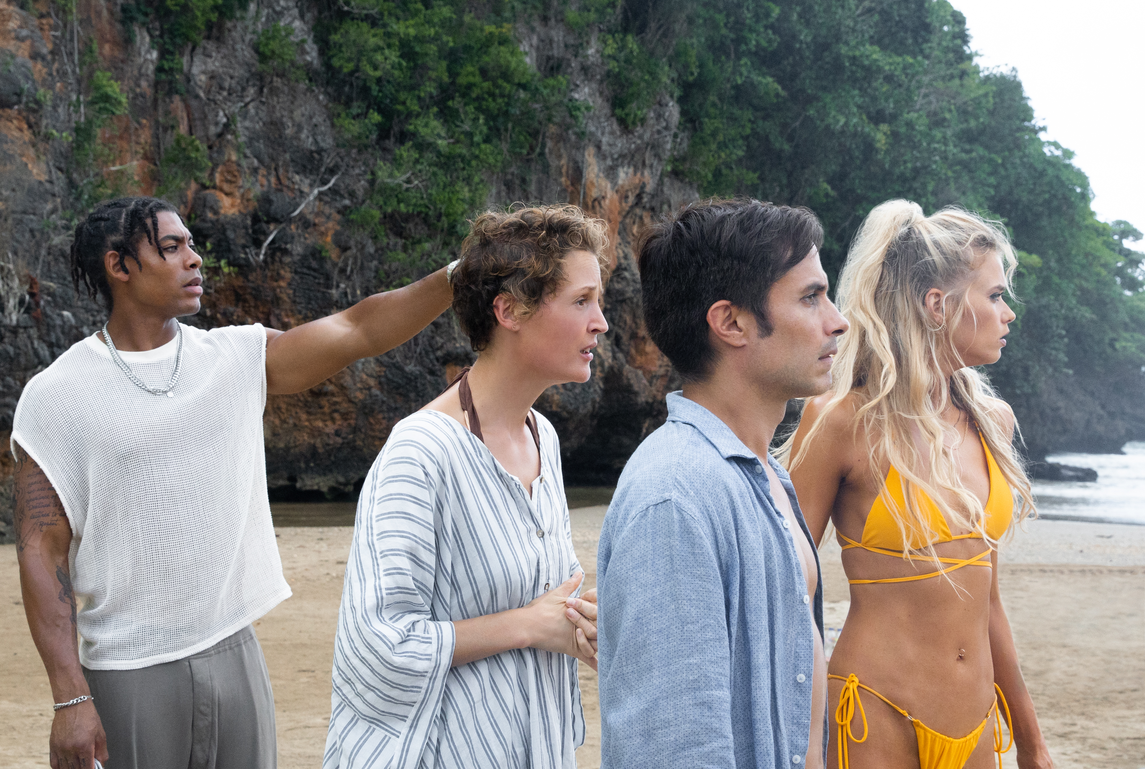 A group of vacationers stranded on the beach in M. Night Shyamalan's Old.